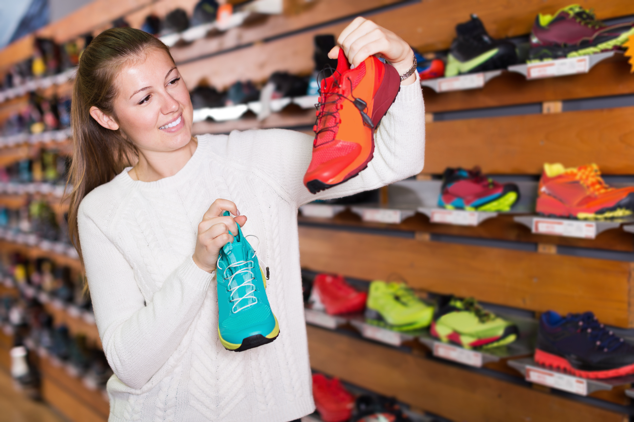 Young girl chooses clothes or shoes in sports shop (Thinkstock/PA)