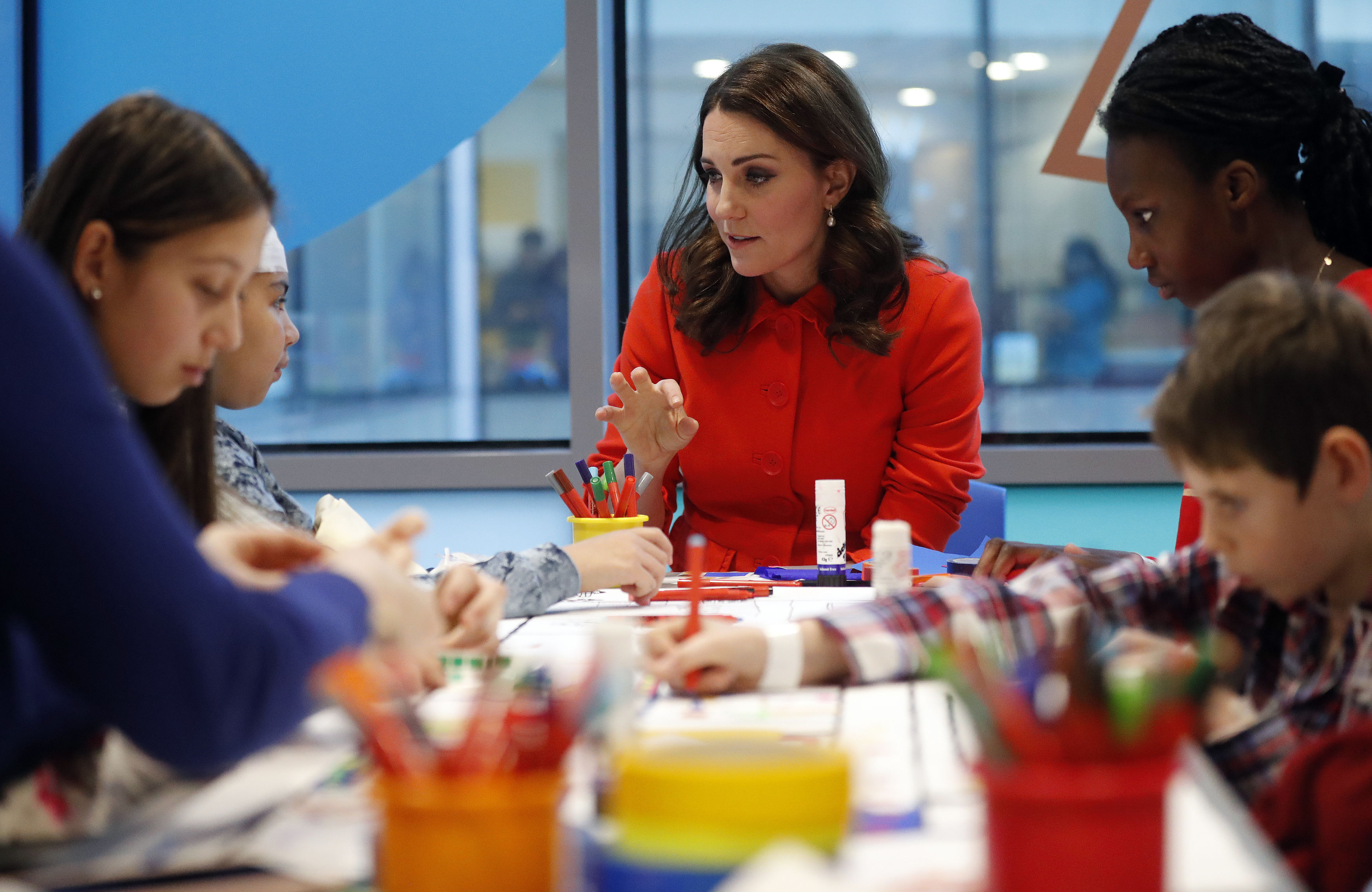 The Duchess of Cambridge speaks to patients as she officially opens the Mittal Children's Medical Centre during a visit to Great Ormond Street Hospital