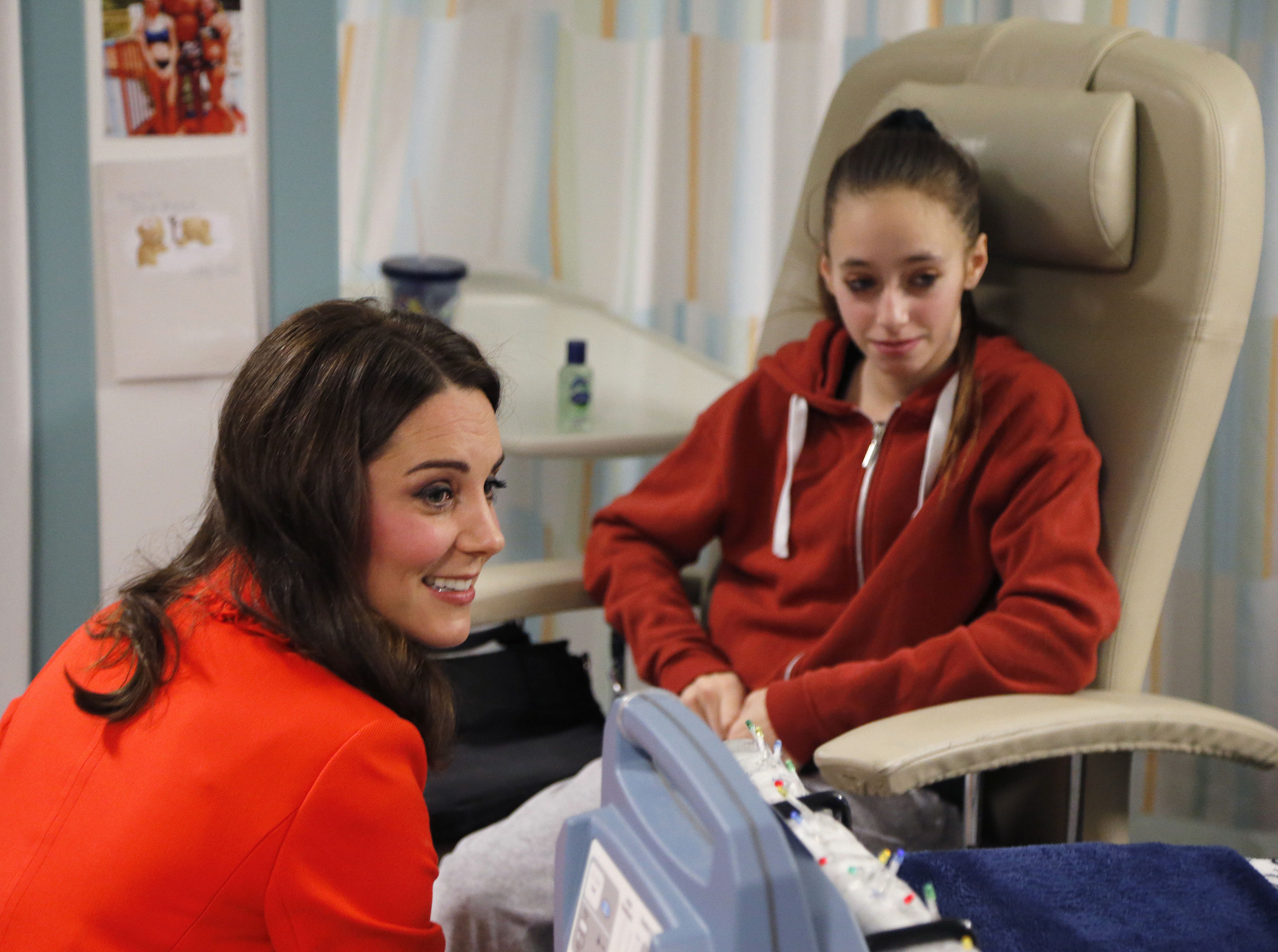 The Duchess of Cambridge  with patient Gabriella Cook, 13, as she officially opens the Mittal Children's Medical Centre during a visit to Great Ormond Street Hospital