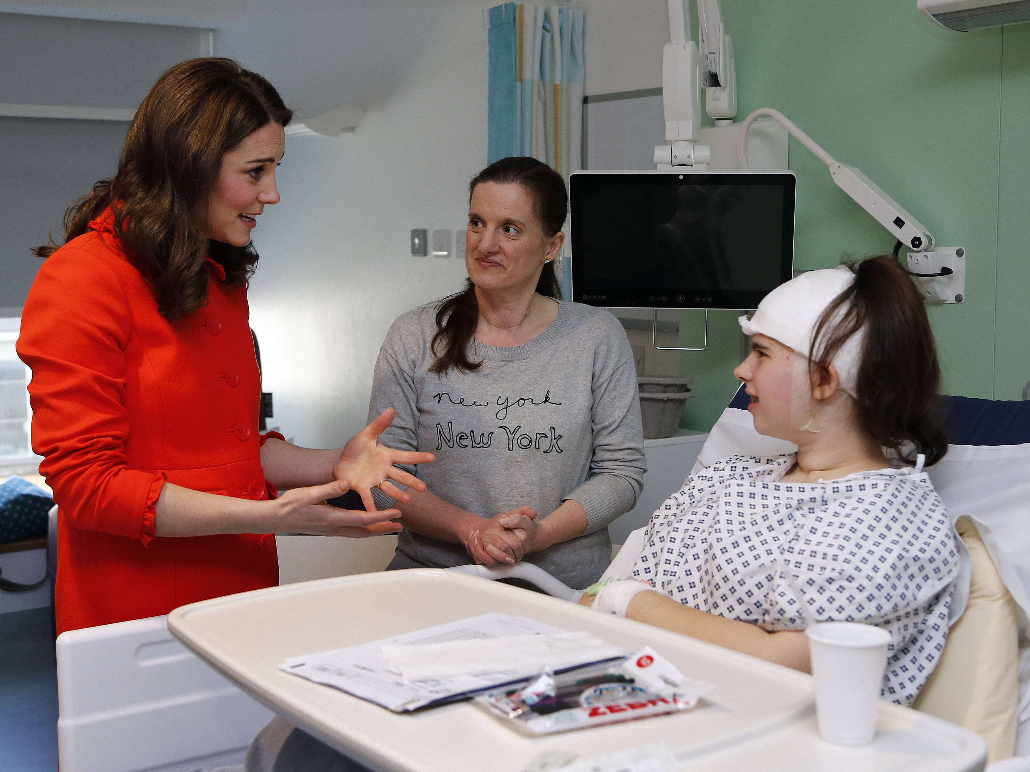 The Duchess of Cambridge speaks to patient Oriel Gray, 14, as she officially opens the Mittal Children's Medical Centre during a visit to Great Ormond Street Hospital