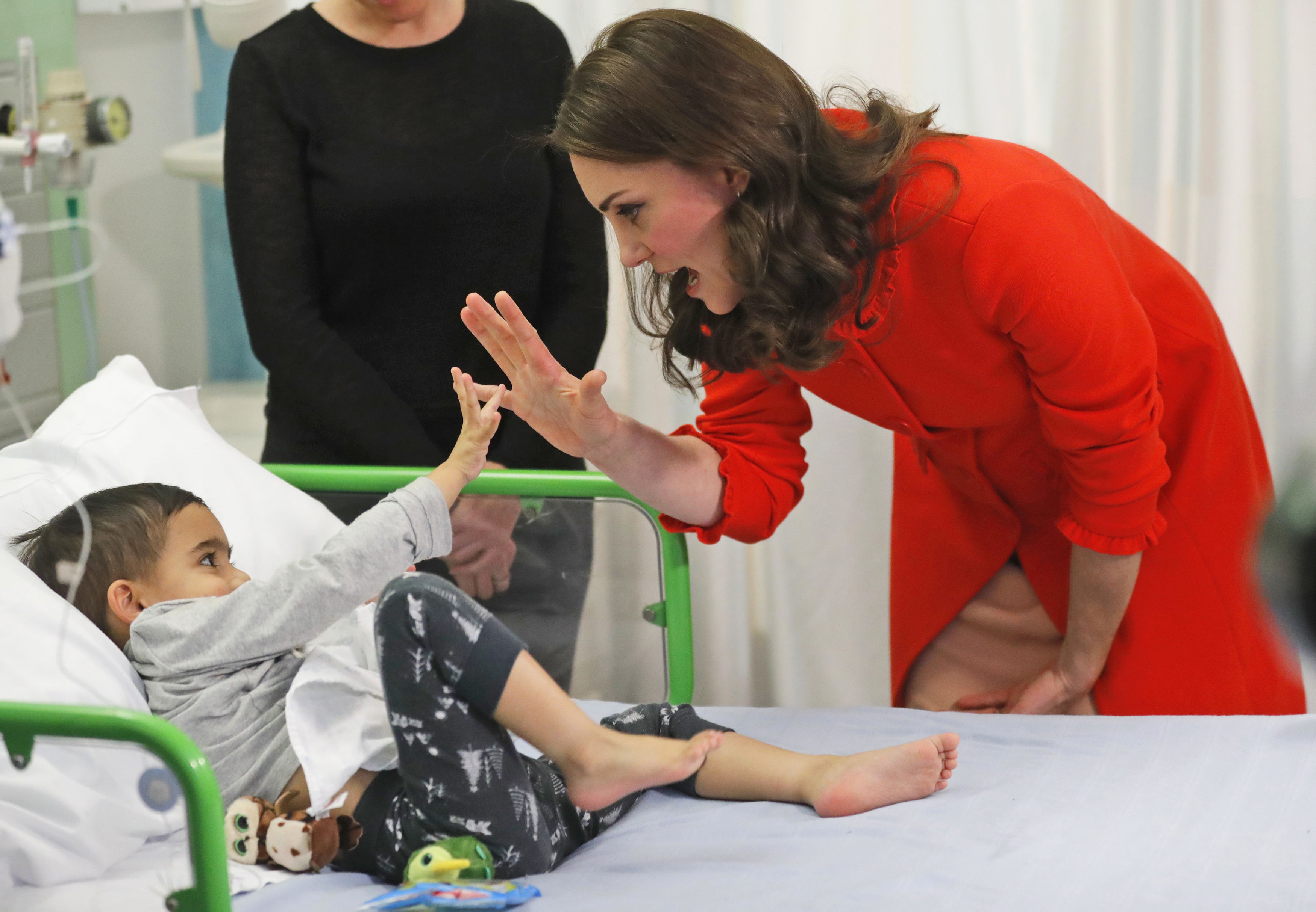 The Duchess of Cambridge with four year old Rafael Chana as she officially opens the Mittal Children's Medical Centre during a visit to Great Ormond Street Hospital