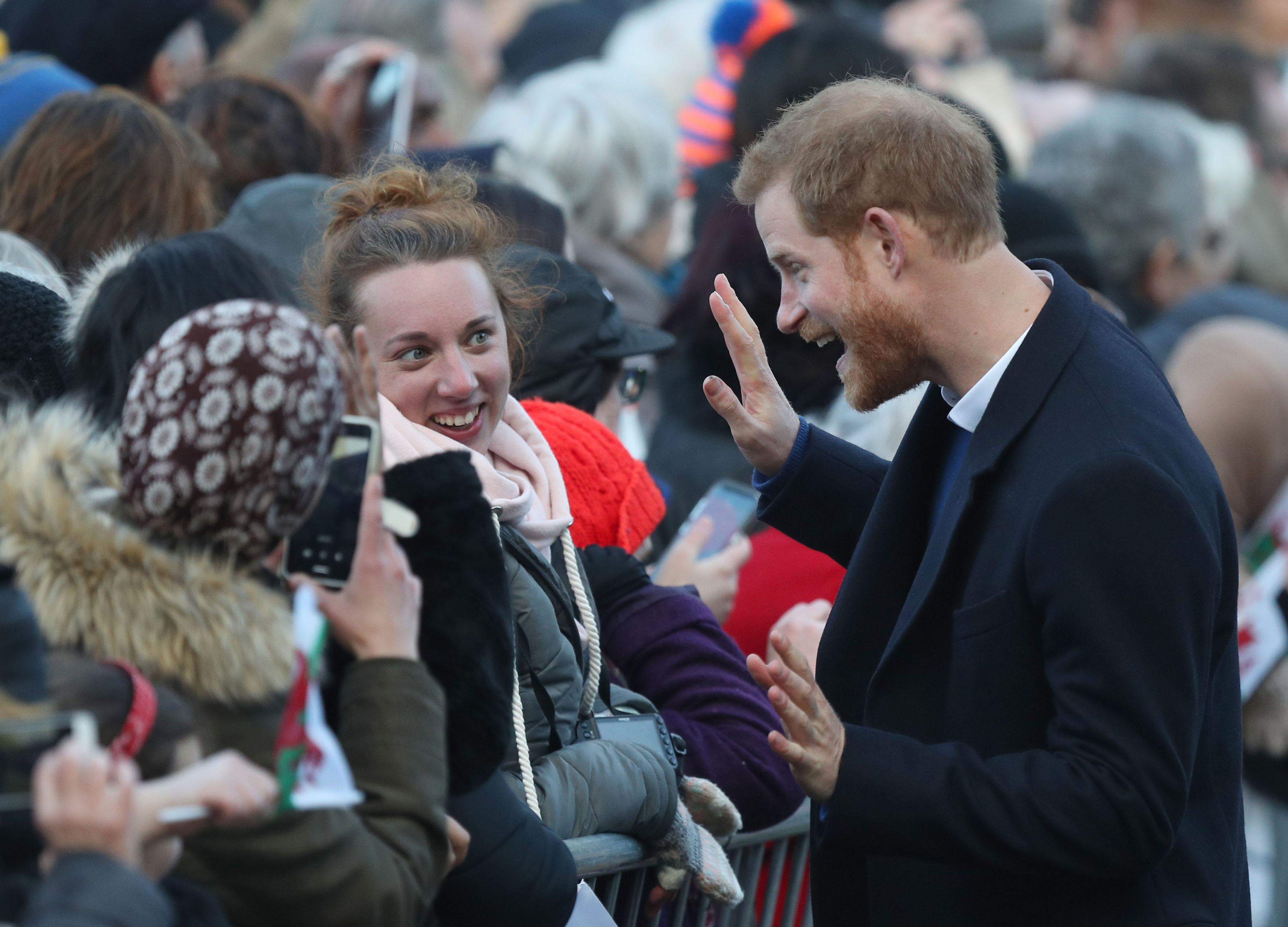 Prince Harry greets well-wishers in Cardiff Andrew Matthews/PA)