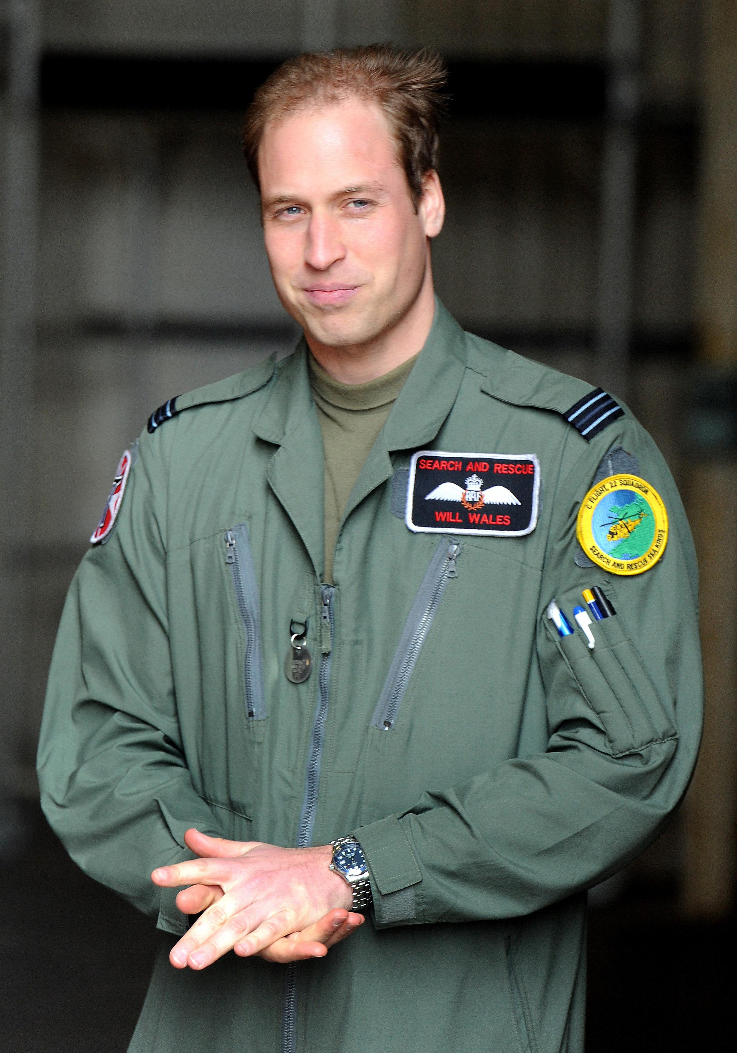 William standing in a helicopter hanger after saying goodbye to Britain's Queen Elizabeth II and the Duke of Edinburgh during a visit to RAF Valley in Anglesey in April 2011 (John Stillwell/PA)