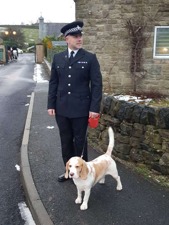 A police officer with Pc Dave Fields's dog, Bertie, ahead of the funeral in Sheffield (Dave Higgens/PA)