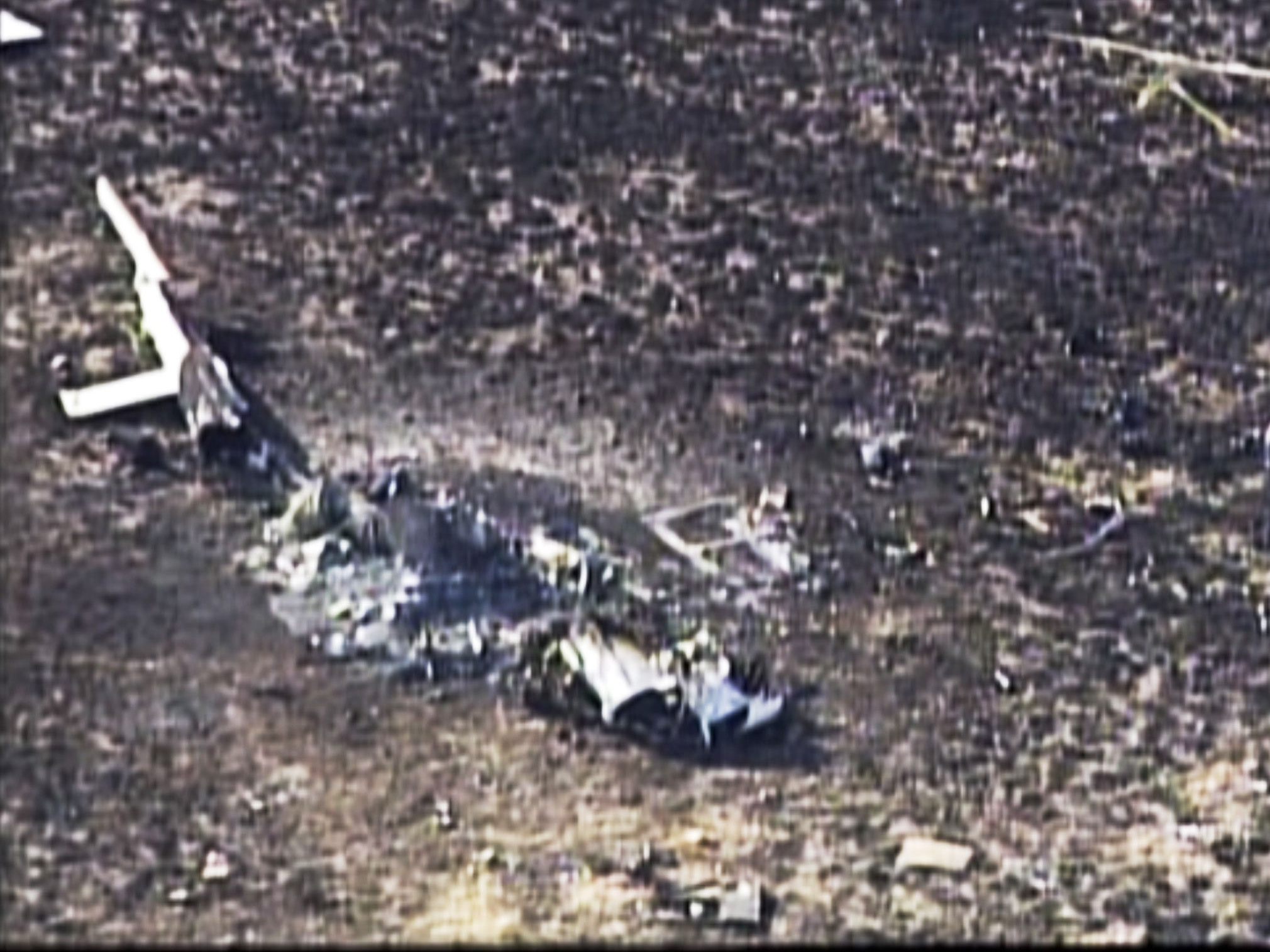 Frame from video showing the wreckage of a helicopter that crashed in a mountainous rural area of northern New Mexico