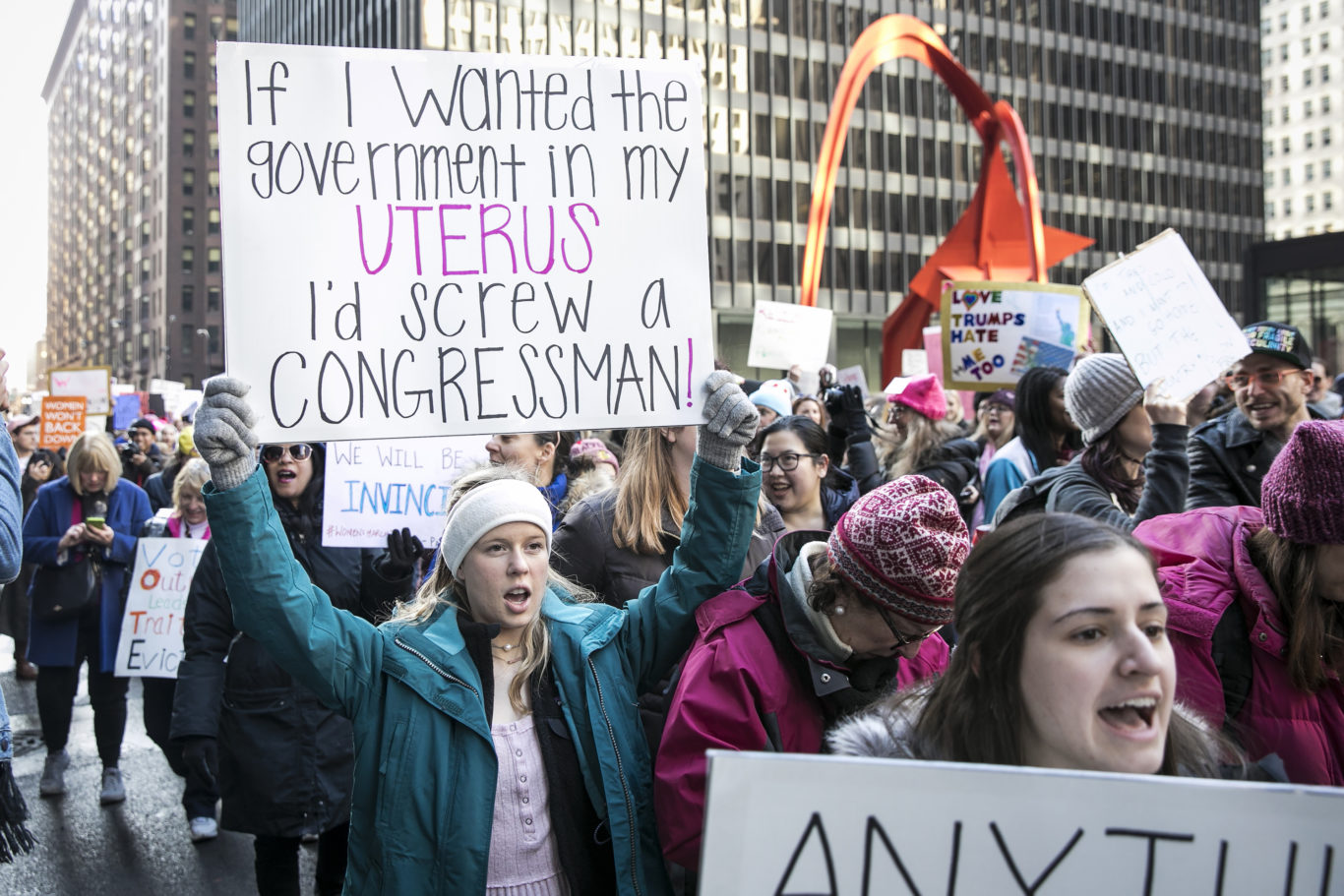 A woman's witty sign in Chicago on Saturday (Ashlee Rezin/AP)