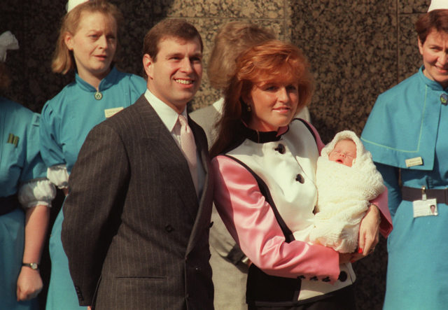 The Duke and Duchess of York pause outside the Portland Hospital in London in March 1990 with new arrival Princess Eugenie (Martin Keene/PA)