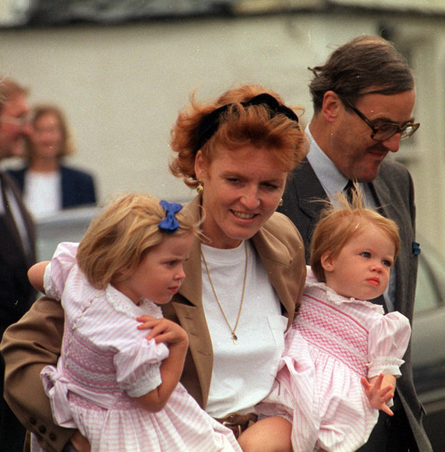 Princess Eugenie (right) joins her mother and sister Princess Beatrice at Corpach, near Fort William in August 1991, as they boarded the royal barge to join Britannia (Chris Bacon/PA)