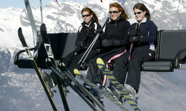 The Duchess of York rides a ski-lift with Beatrice (left) and Eugenie (right) above the slopes of Verbier in Switzerland (Gareth Fuller/PA)