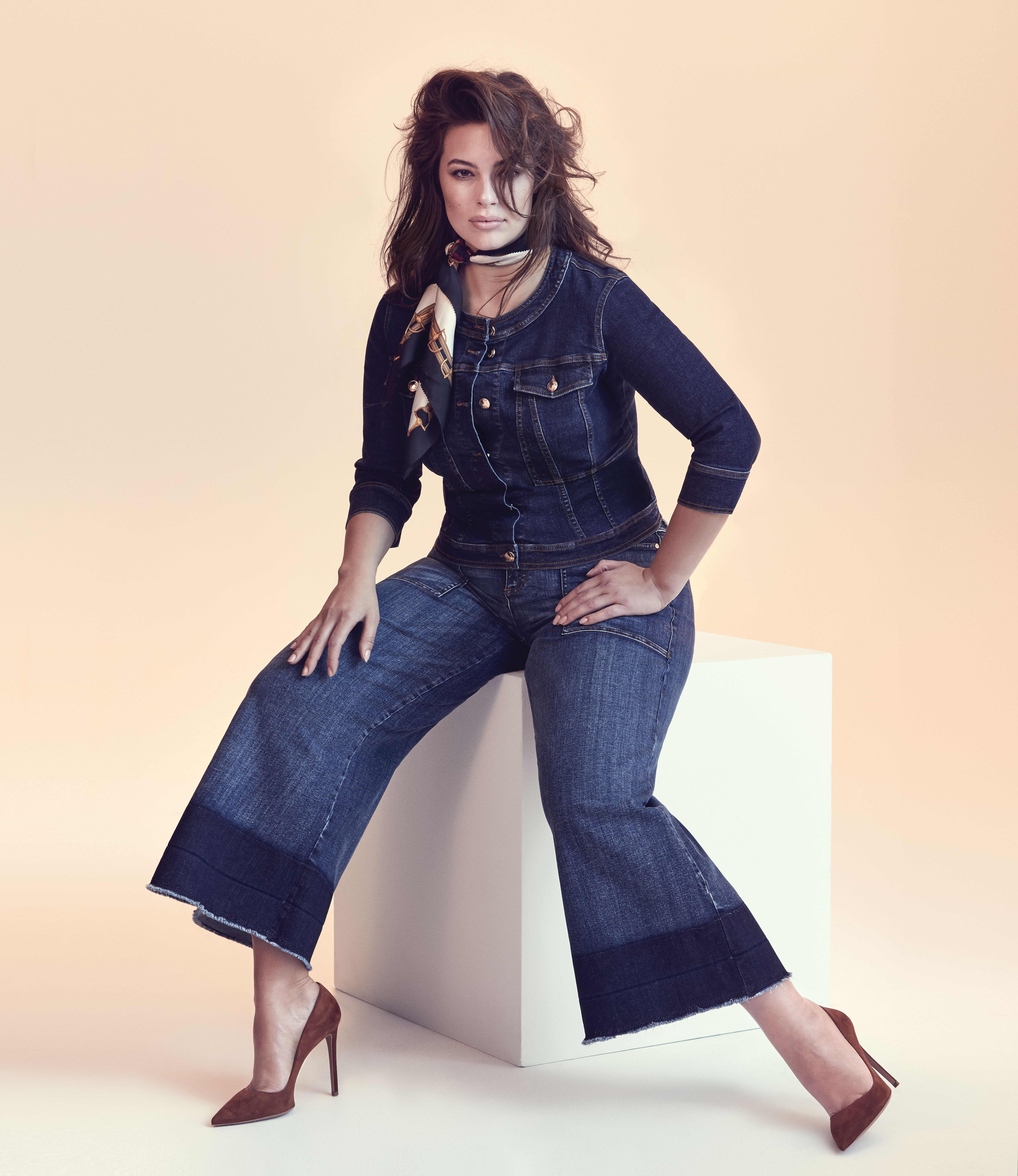 6863574f1390d Ashley Graham wears a denim jumpsuit from her collection for Marina Rinaldi  at Navabi