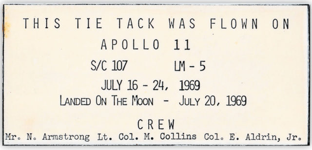 The laminated card that accompanies the pin flown on the Apollo 11 mission (Henry Aldridge & Son/PA)