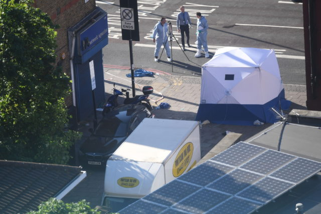A forensic tent stands next to a van in Finsbury Park, north London, after Makram Ali, 51, died following an alleged  terror attack (Victoria Jones/PA)