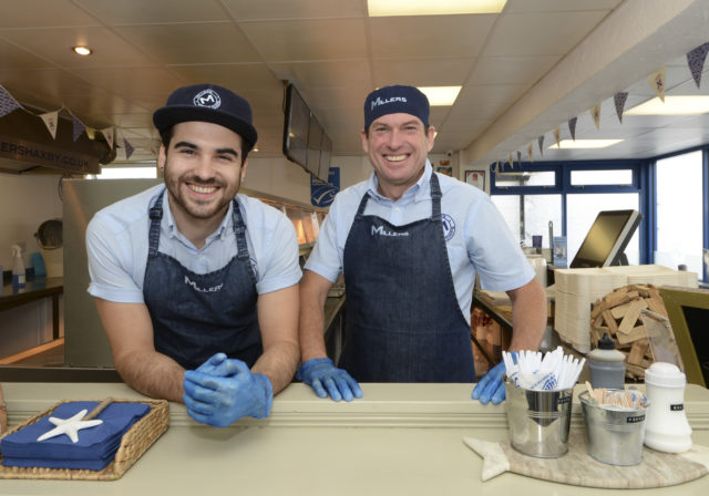 Nick Miller, left, and father David Miller, of Millers Fish and Chips, Haxby, North Yorkshire (Mike Cowling/PA)
