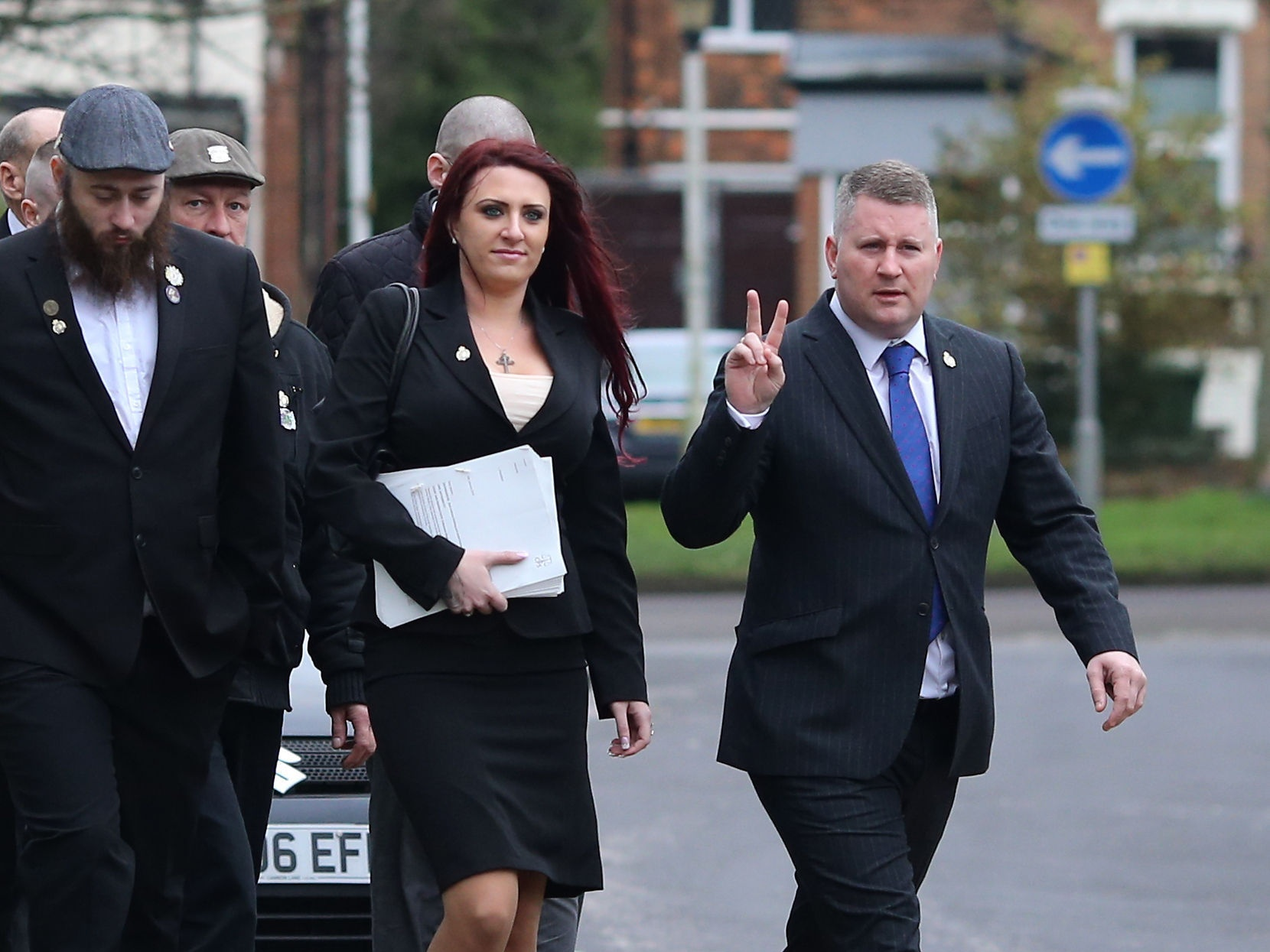 Jayda Fransen and Paul Golding (right) with supporters (Gareth Fuller/PA)
