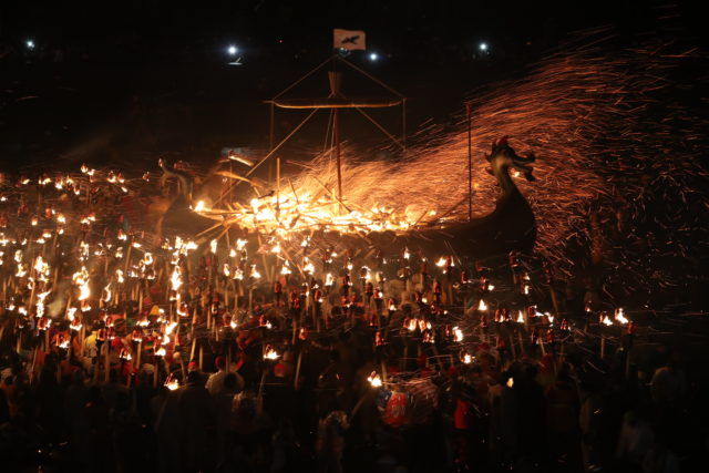 Members of the Jarl Squad set fire to their Viking longship during the Up Helly Aa Viking festival in Lerwick (Jane Barlow/PA)