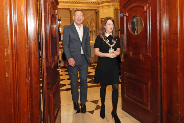 Sir Kenneth Branagh arrives with Belfast Lord Mayor Nuala McAllister at City Hall (Niall Carson/PA)