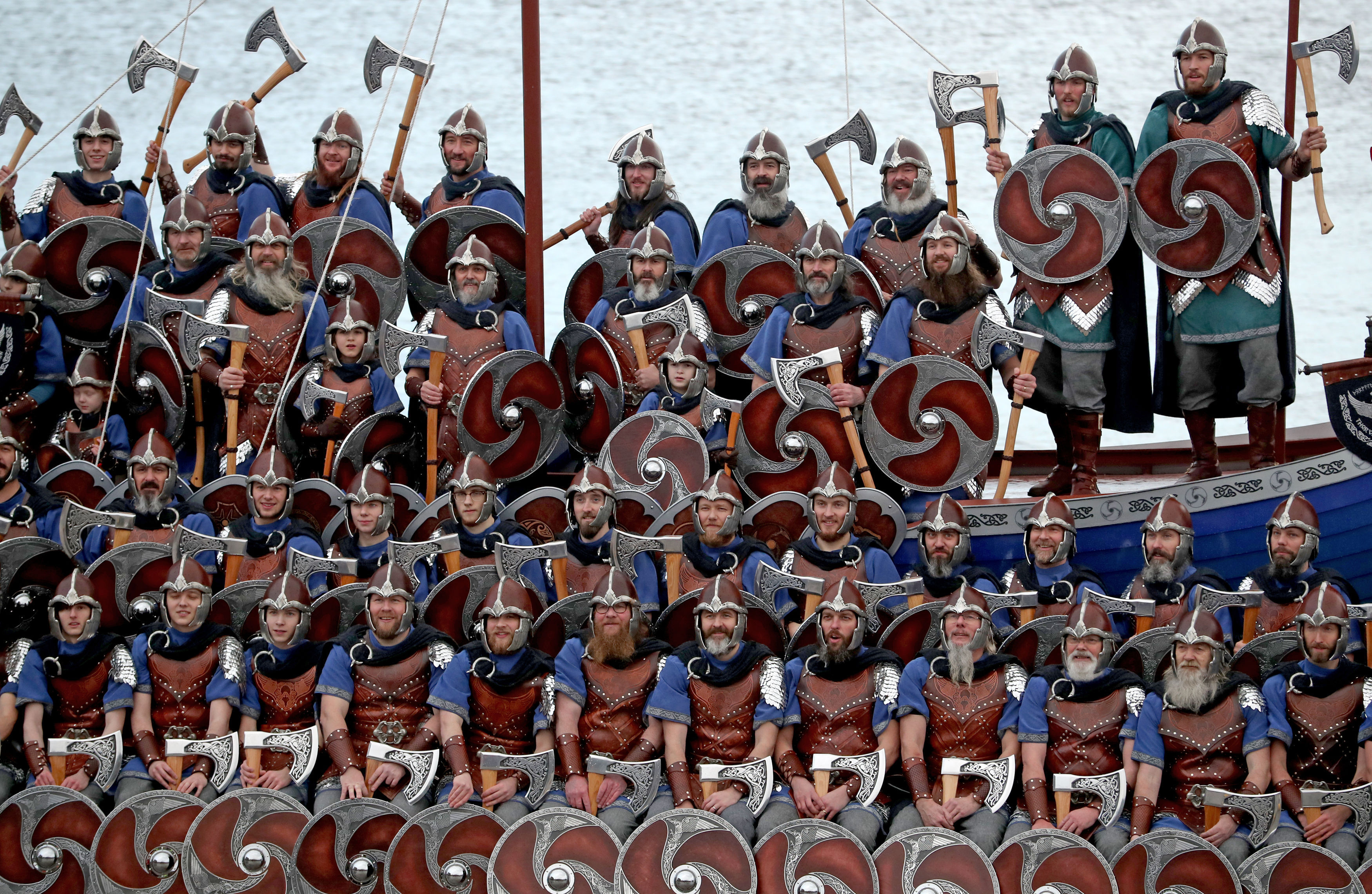 Members of the Jarl Squad dressed in Viking suits on the galley (Jane Barlow/PA)