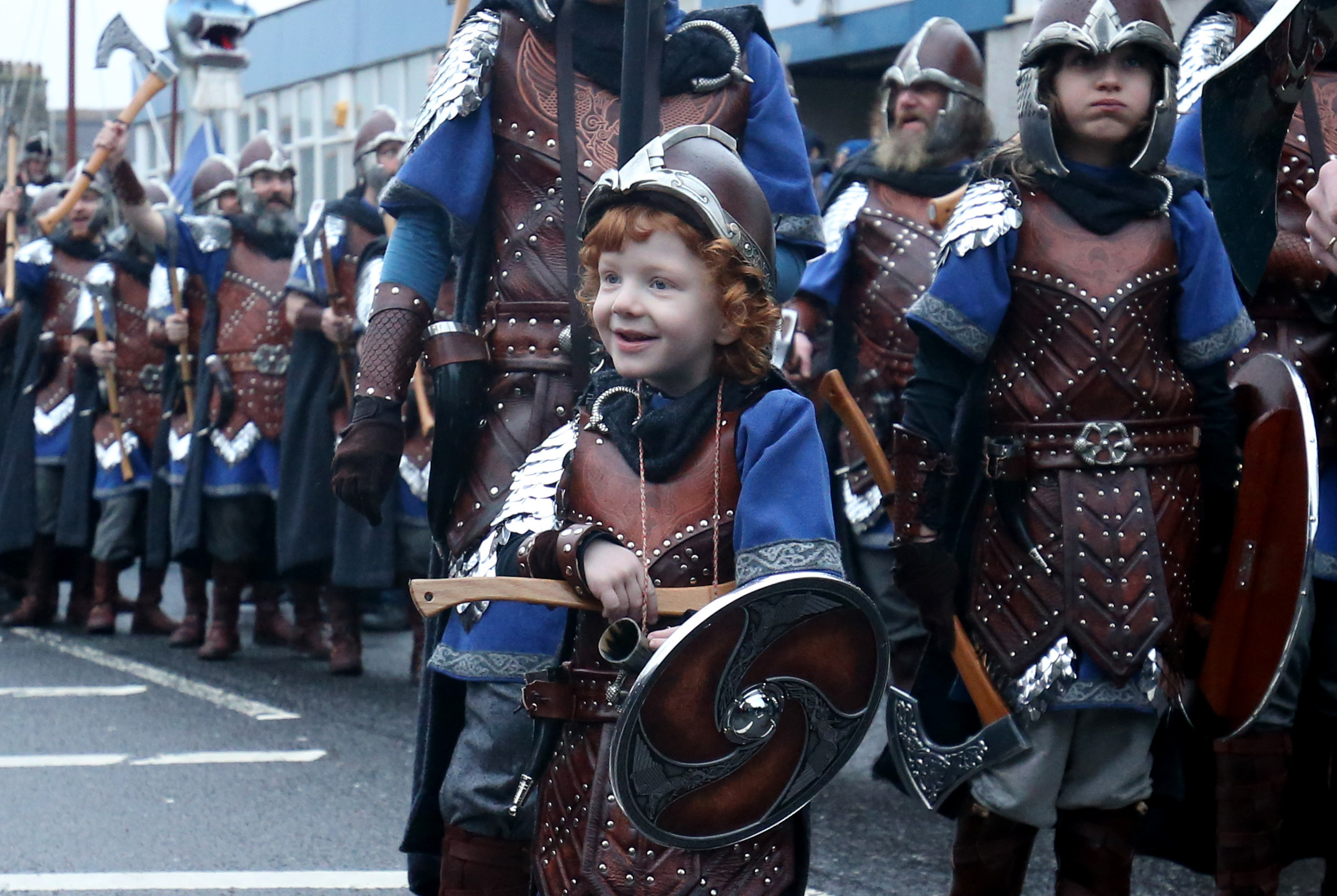 Odin, four, leads his army through the streets of Lerwick (Jane Barlow/PA)