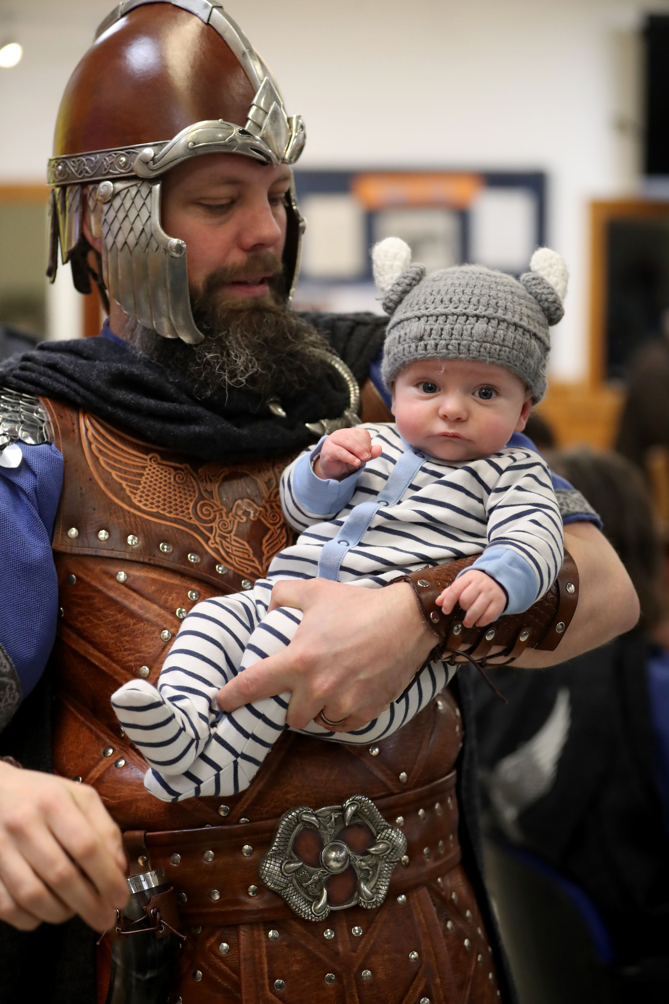 Magnus Johnston, a member of the Jarl Squad dressed in his Viking suit, with his three-month-old son Calum (Jane Barlow/PA)