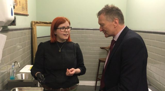 Jessica Nicholas from Frontier Tattoo Parlour, Cardiff, talking to Dr Frank Atherton, Chief Medical Officer for Wales (Welsh Government/PA)
