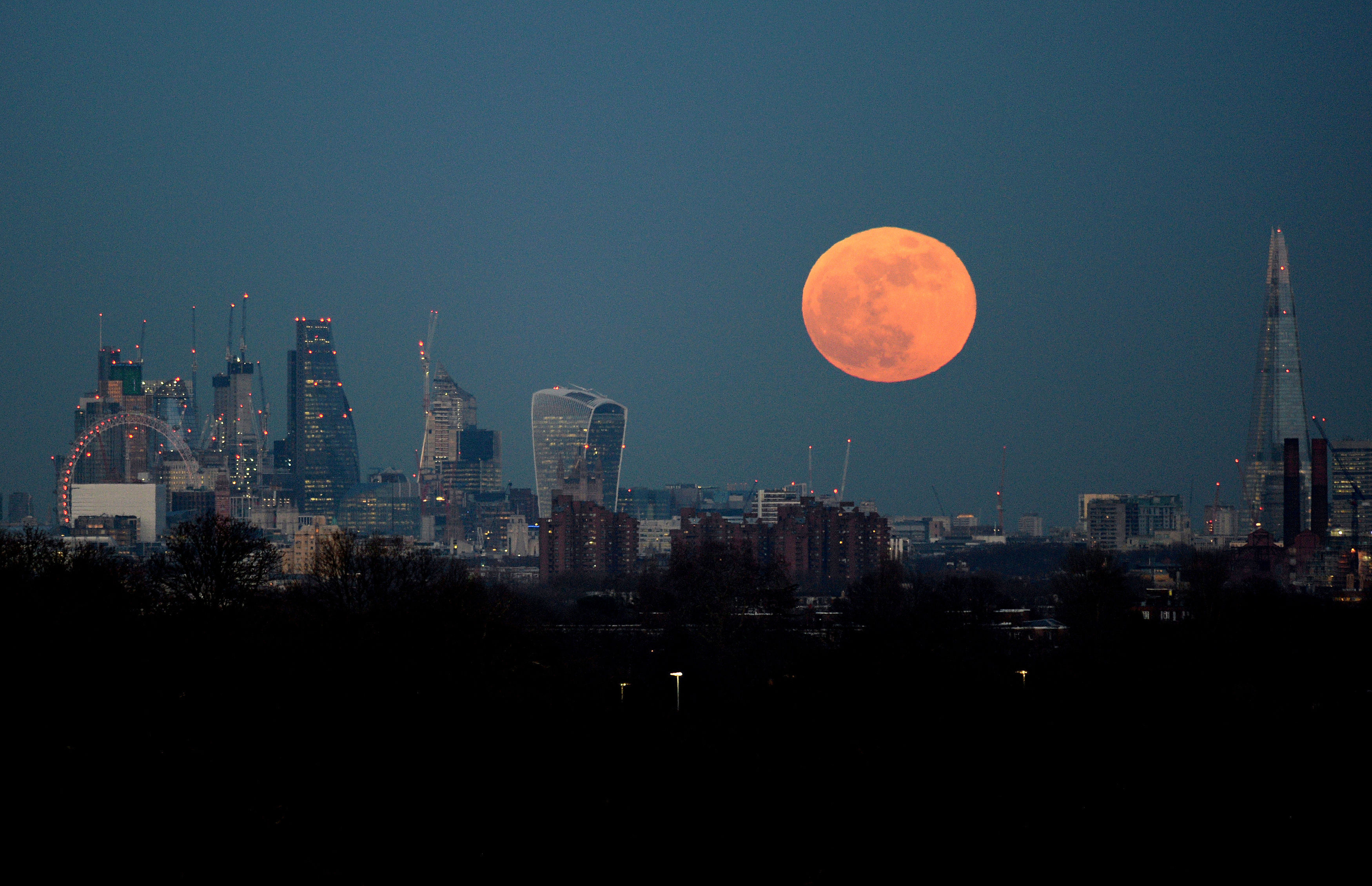 The moon rises over the London skyline (Kirsty O'Connor/PA)