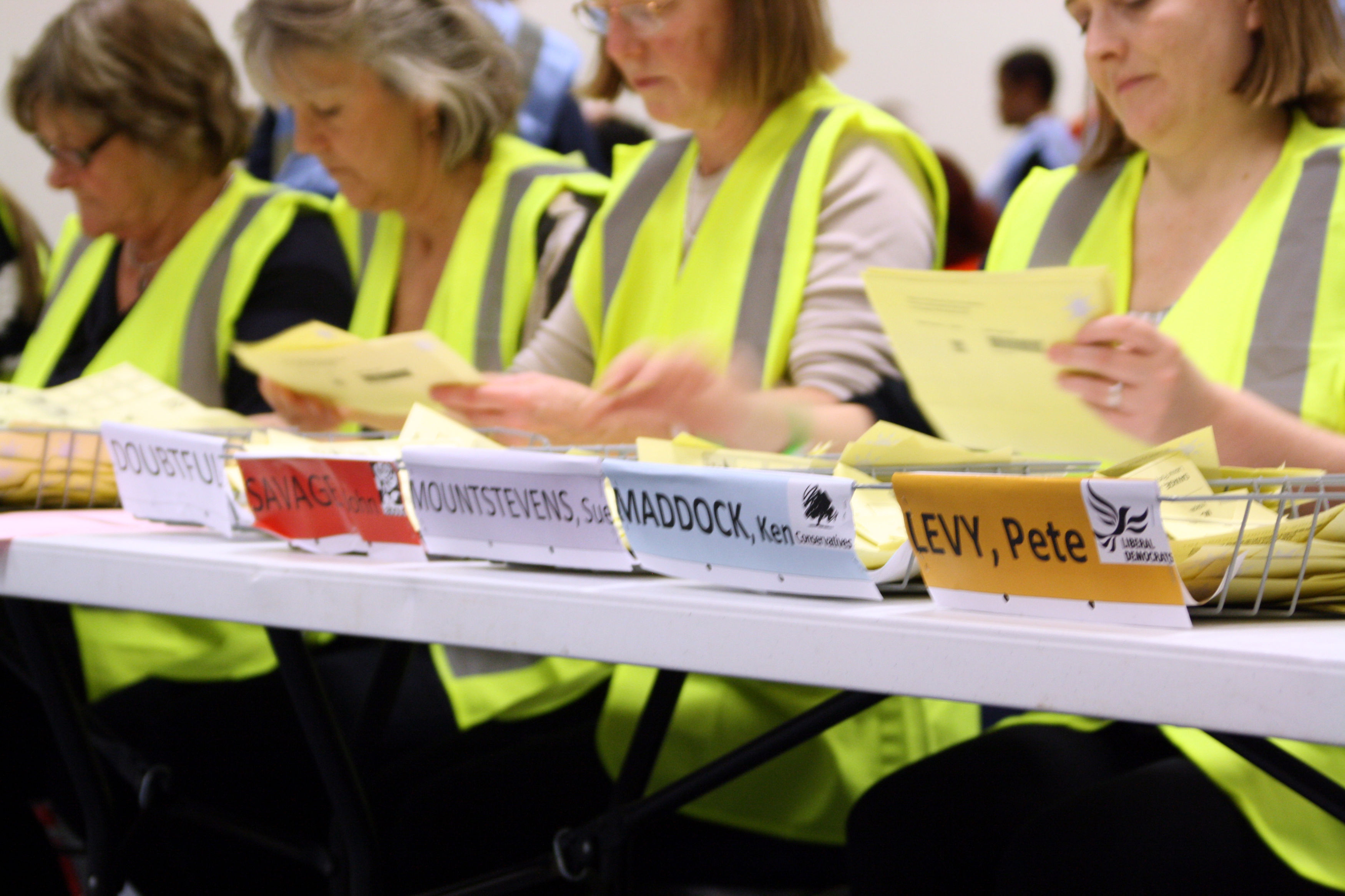 Counting agents sorting ballot papers on election day in 2012