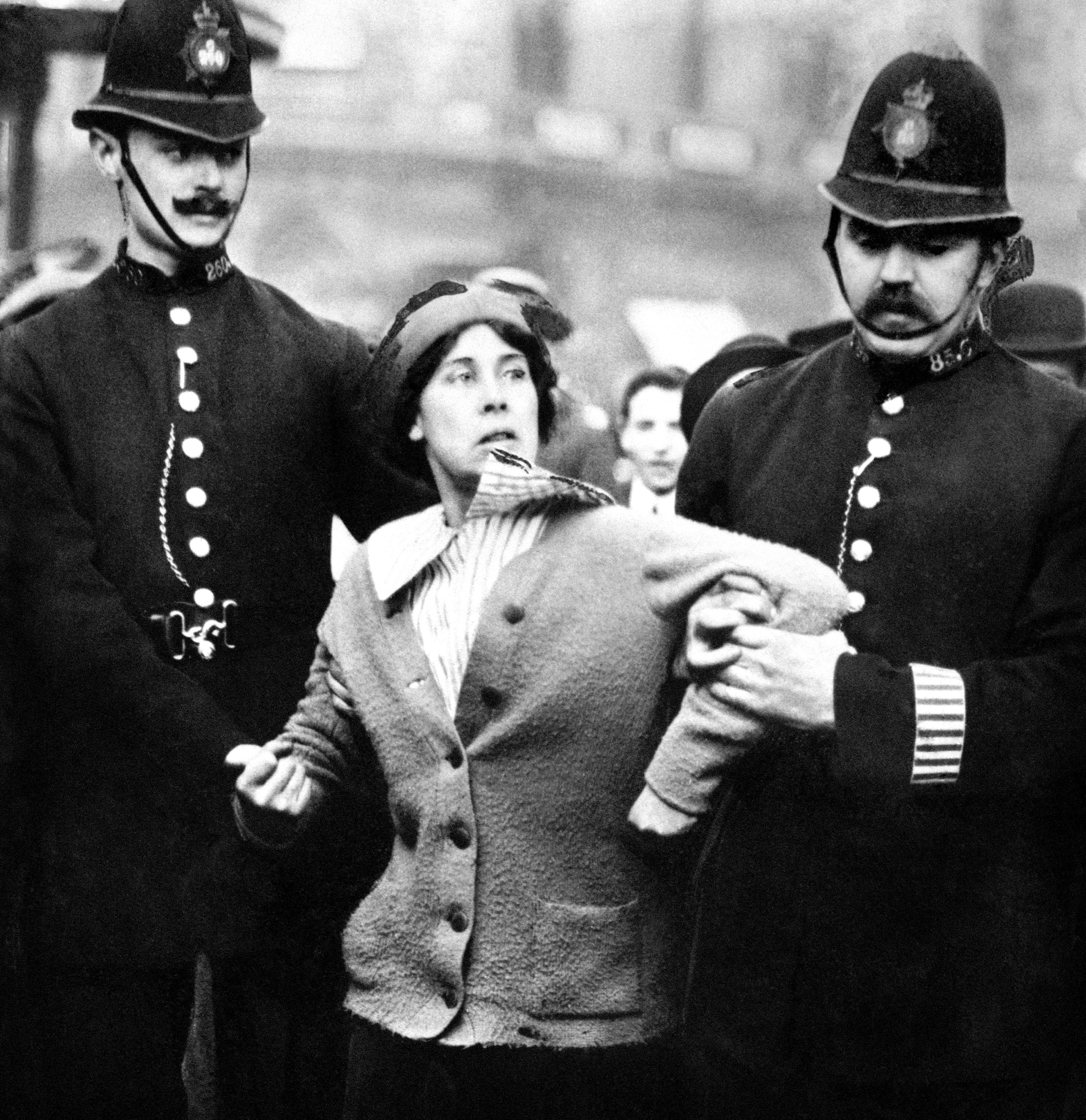 A suffragette being arrested by police officers in 1914 (PA)