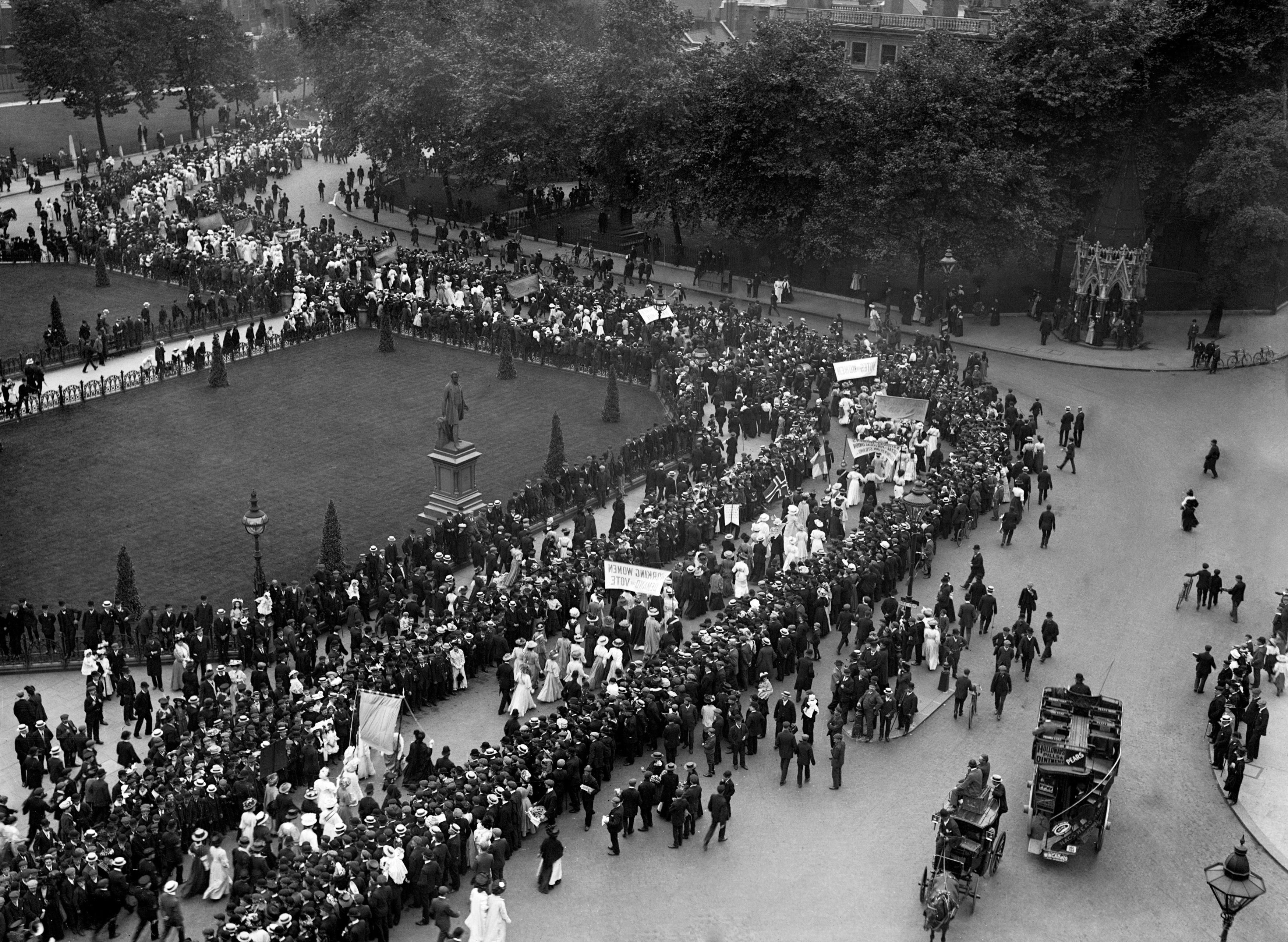 A suffragette procession passing through Parliament Square, London in 1908 (PA)
