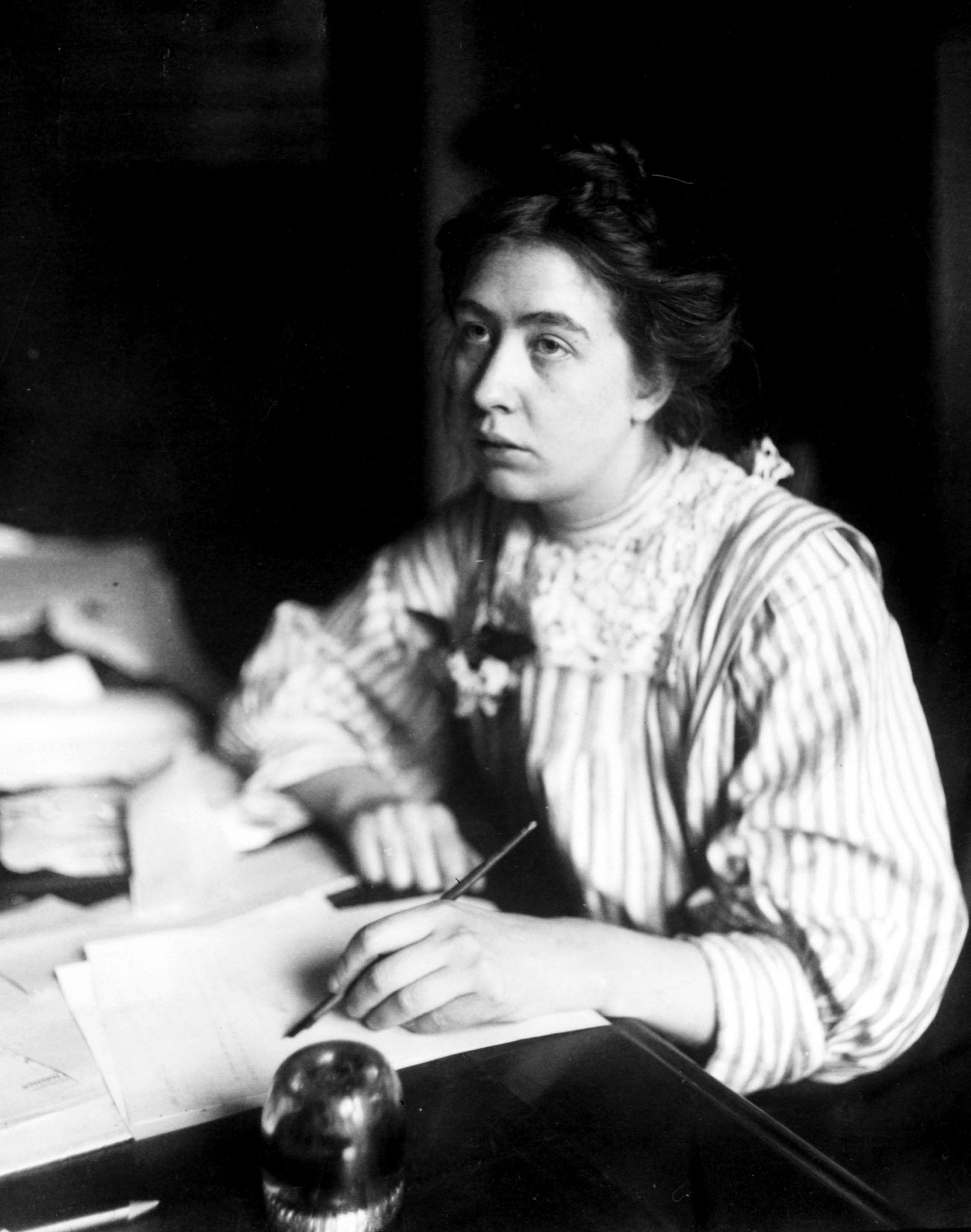 Suffragette Sylvia Pankhurst, who was one of Emmeline Pankhurst's three daughters, at her desk in 1911 (PA)