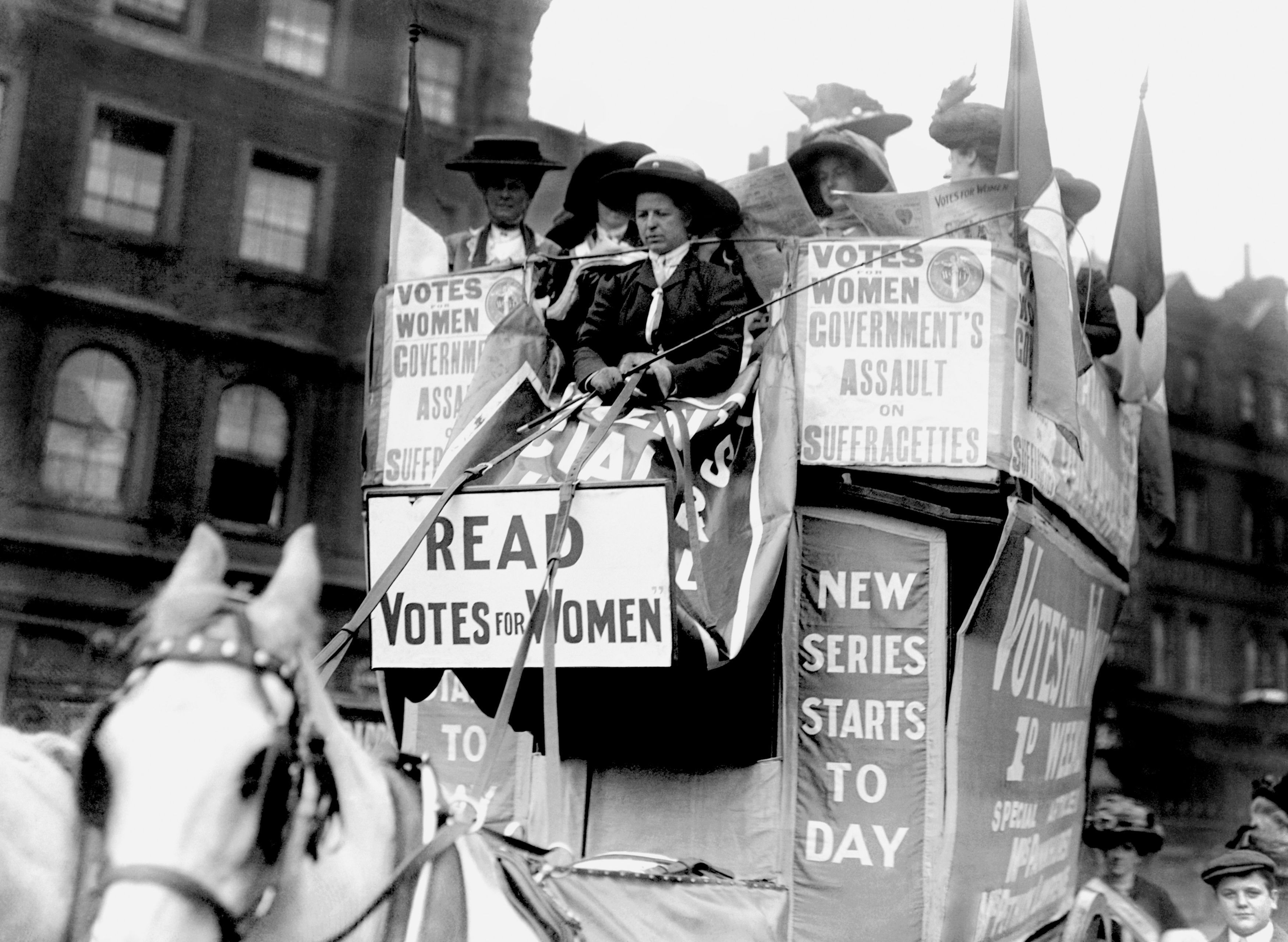 Members of the Women's Social and Political Union (WSPU) on a horse-drawn carriage driven by Emmeline Pankhurst in 1910 (PA)