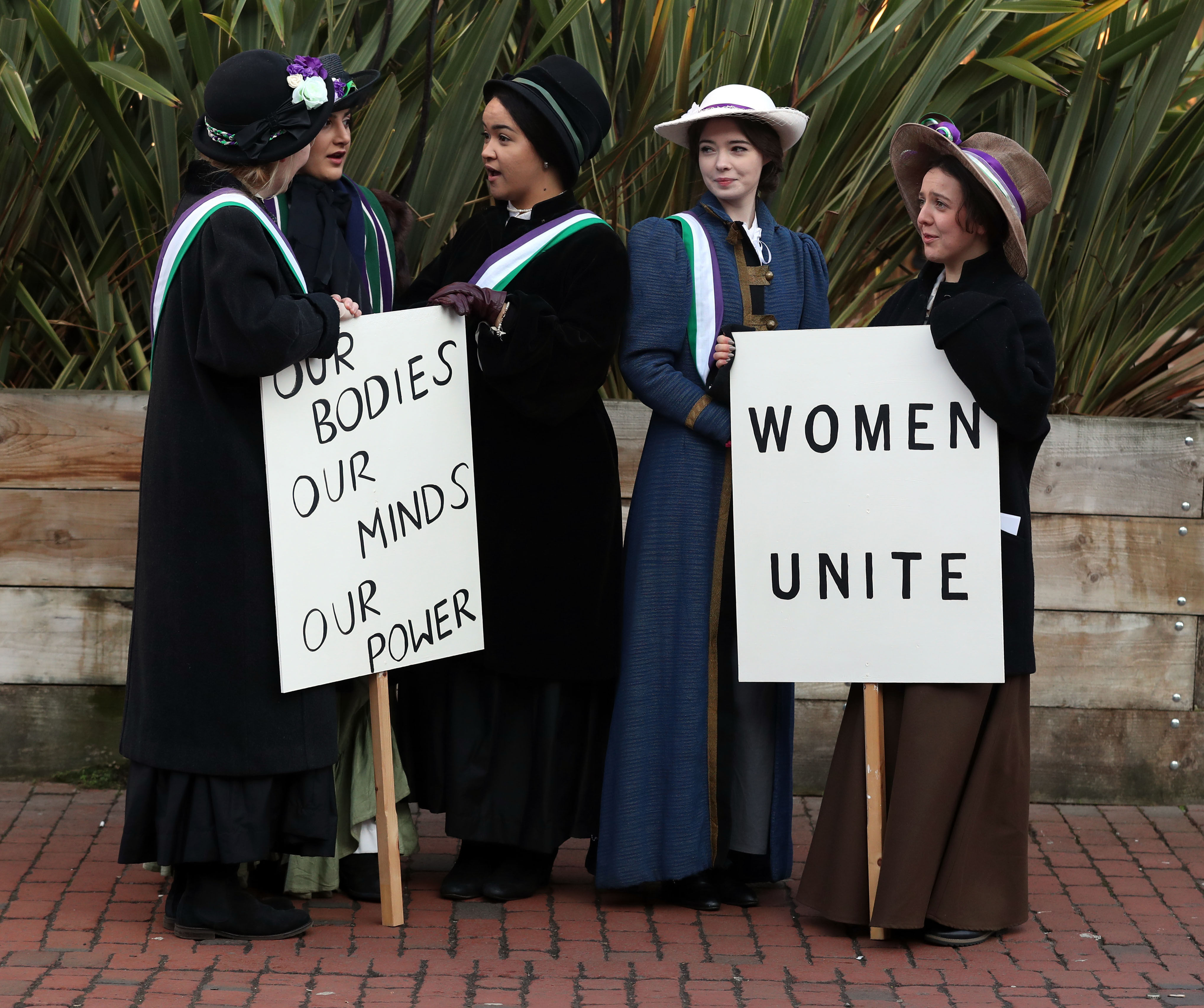 Students from Royal Holloway, University of London recreate a protest march by suffragettes (Steve Parsons/PA)