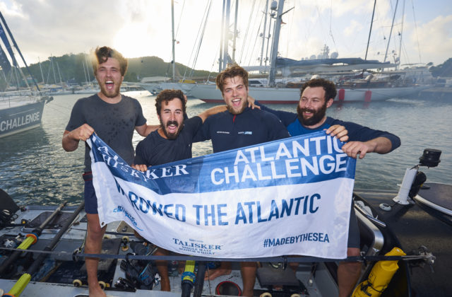 The Bristol-based quartet Steve Baker, Mark Gibson, Dan Baker and Jon Lakin celebrate completing the Talisker Whisky Atlantic Challenge (PA Wire / Ben Duffy)