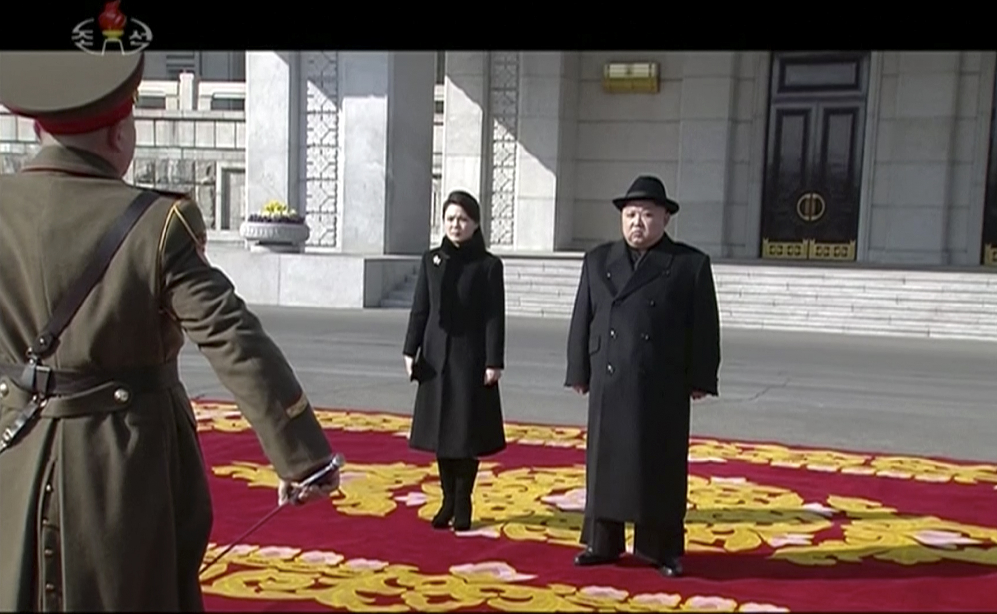 Kim Jong Un and his wife Ri Sol Ju at the parade (KRT via AP)