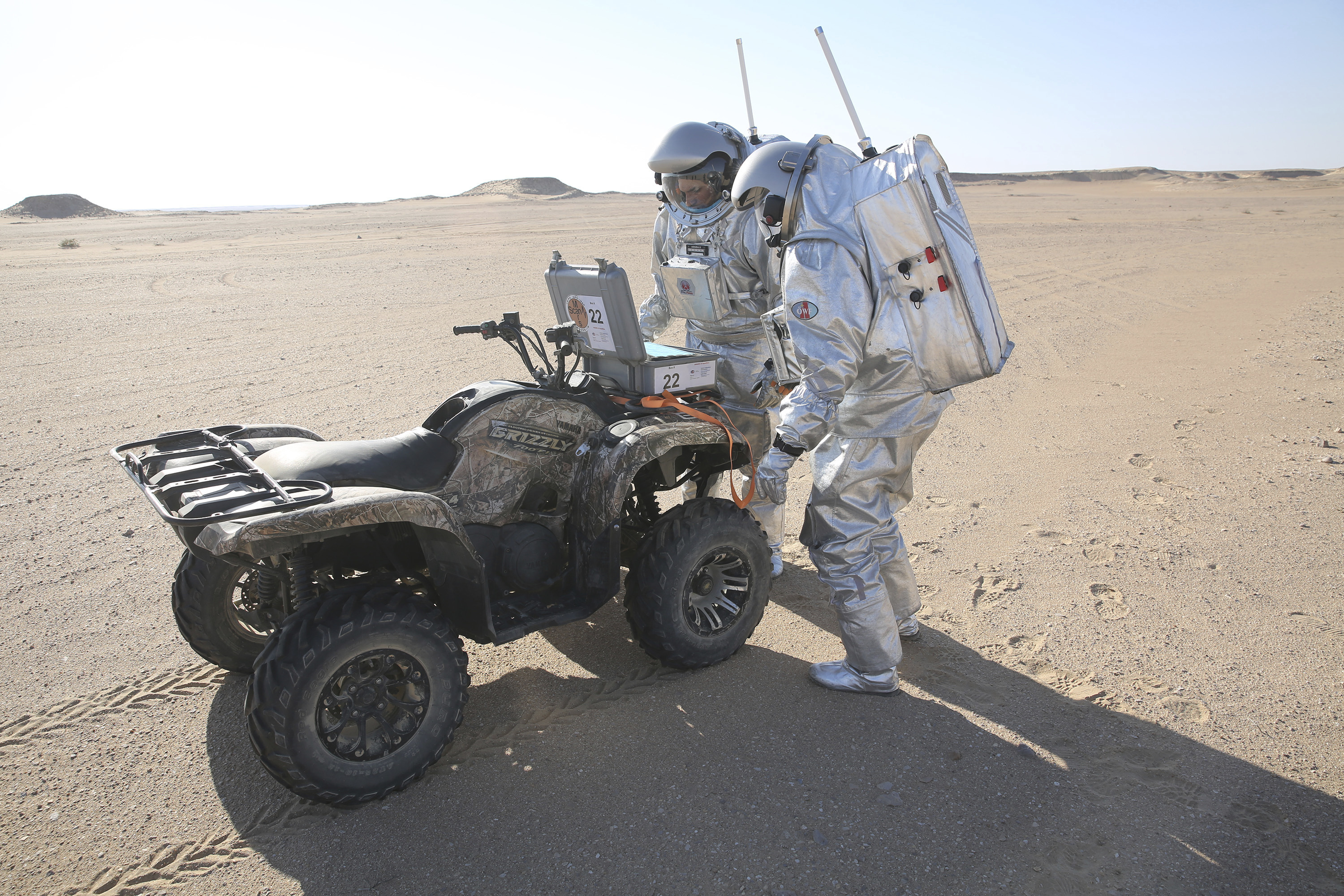 Two scientists test space suits and a geo-radar for use in a future Mars mission in the Dhofar desert of southern Oman (Sam McNeil/PA)