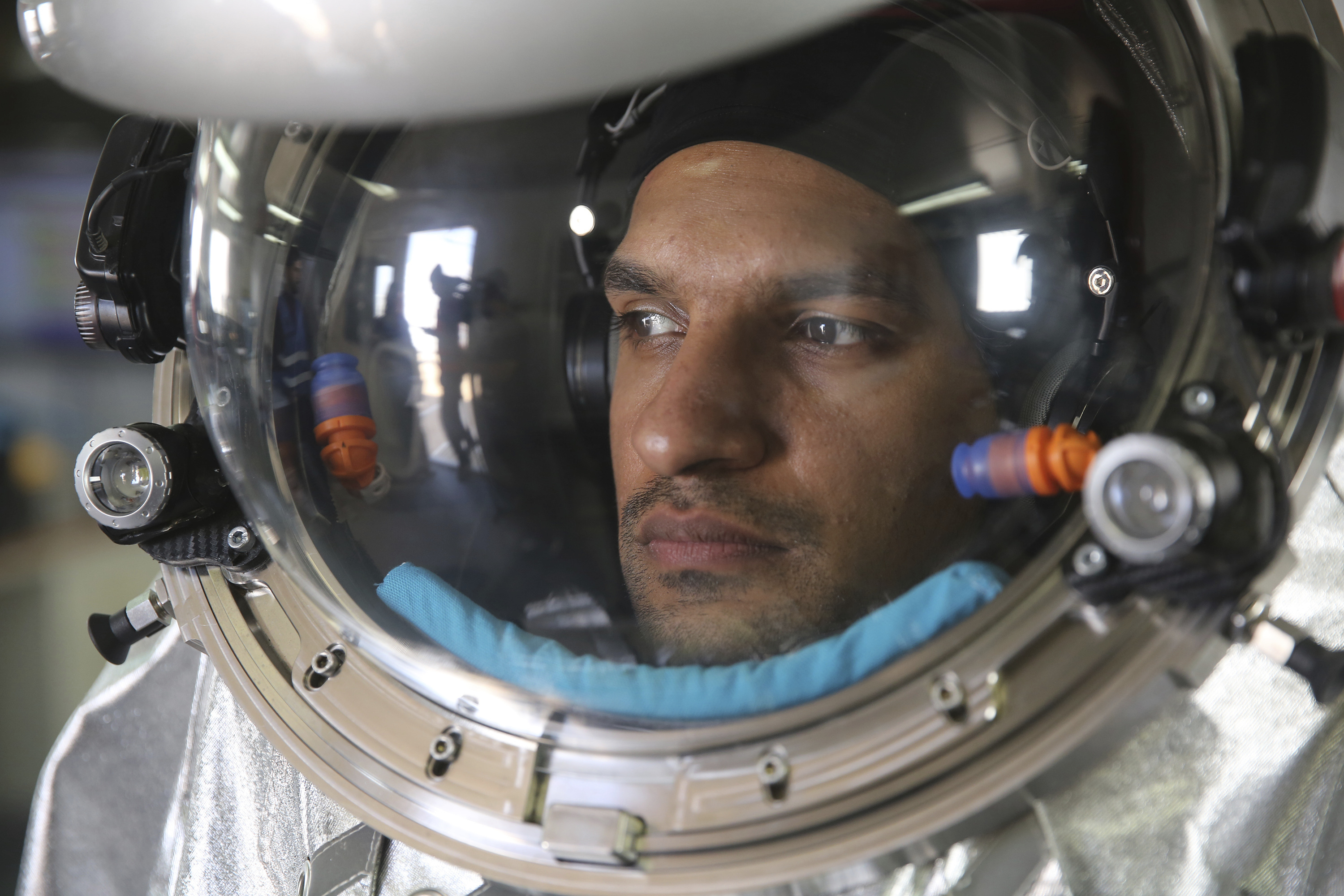 Analogue astronaut Kartik Kumar wearing an experimental space suit during a simulation of a future Mars mission in the Dhofar desert of southern Oman (Sam McNeil/AP)