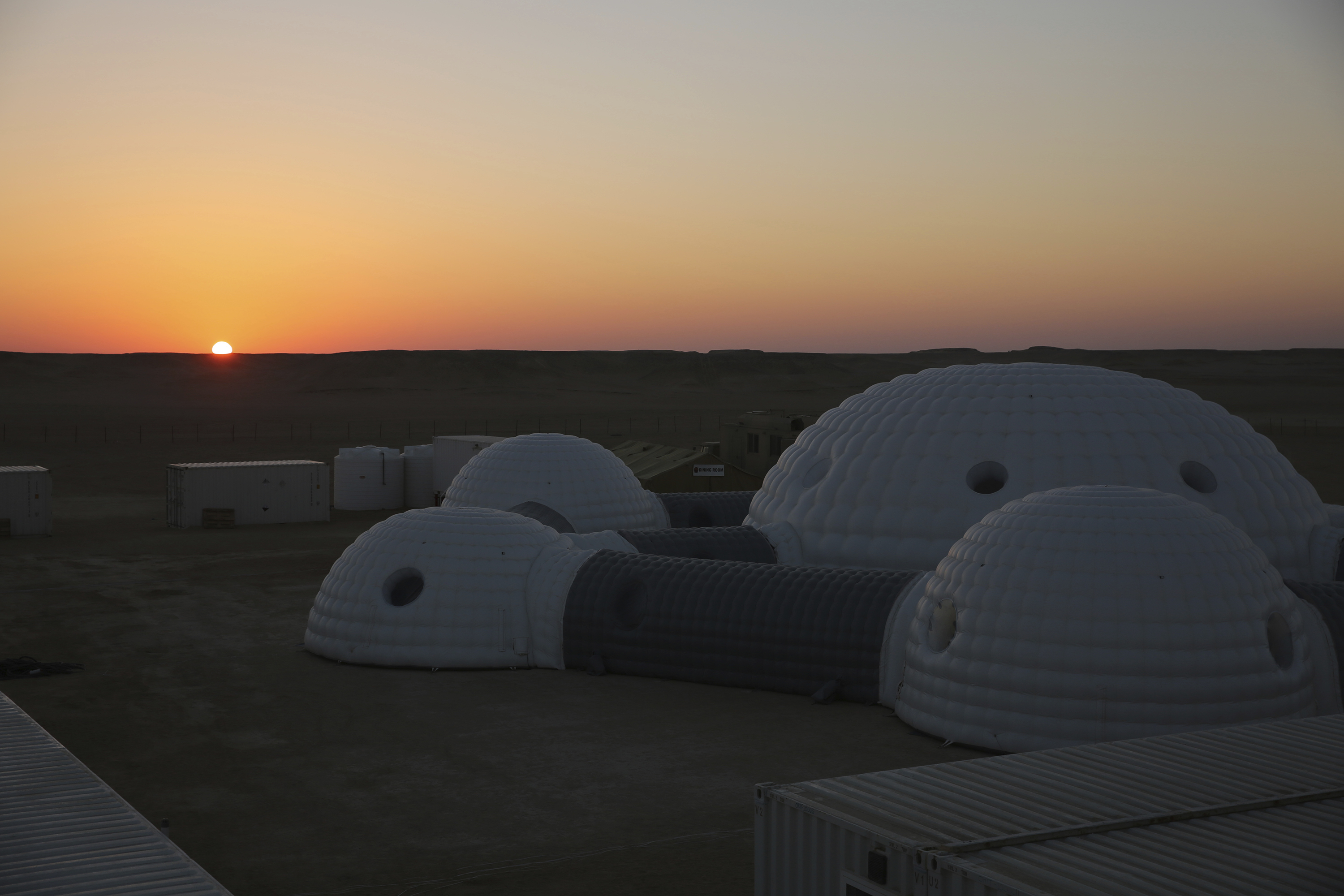 The sun rises over a 2.4-ton inflated habitat used by the AMADEE-18 Mars simulation in the Dhofar desert of southern Oman (Sam McNeil/AP)