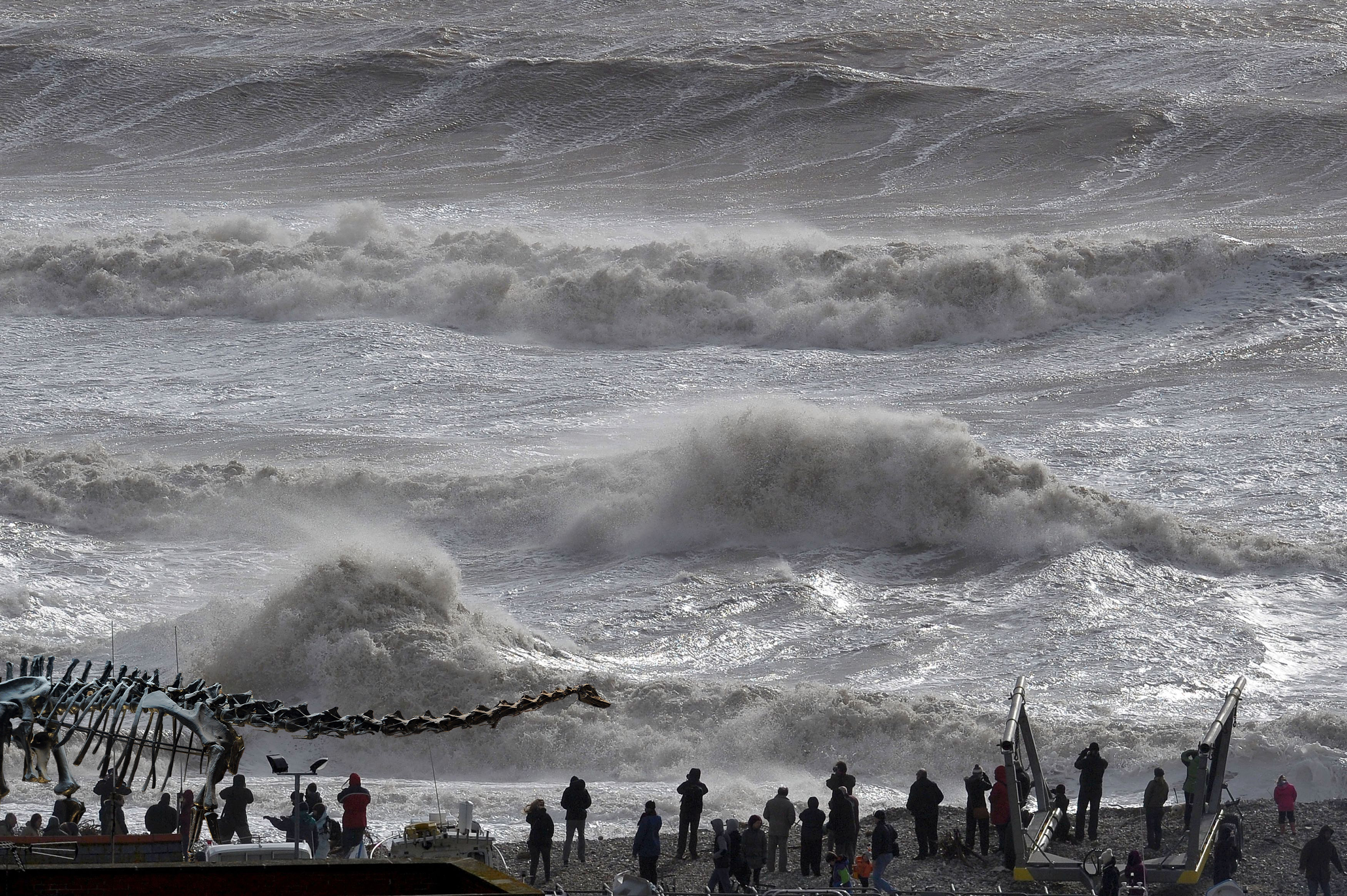 Waves break over the Cobb in Lyme Regis, Dorset as the south coast is battered by stormy weather.