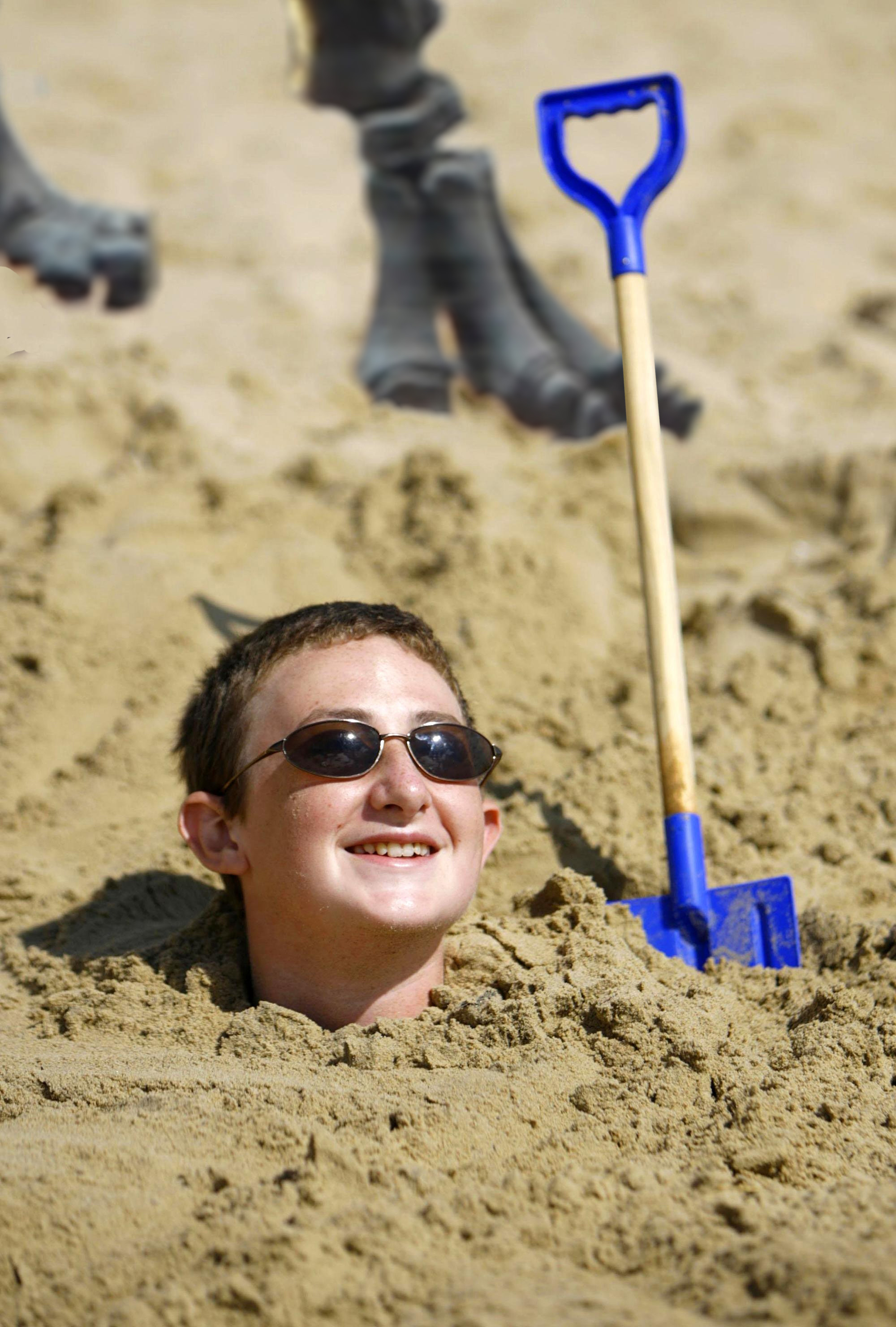 A boy from Southampton enjoys a moment of sunshine on Bournemouth beach in Dorset.