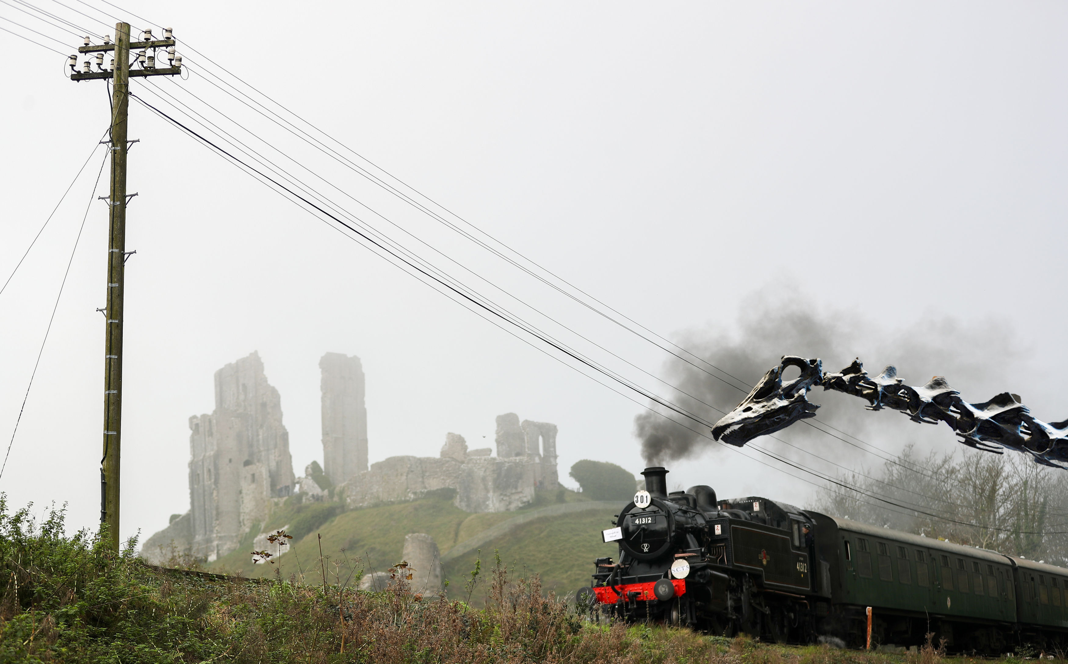 A steam engine on the Swanage Railway line make's it's way past Corfe Castle in Dorset.