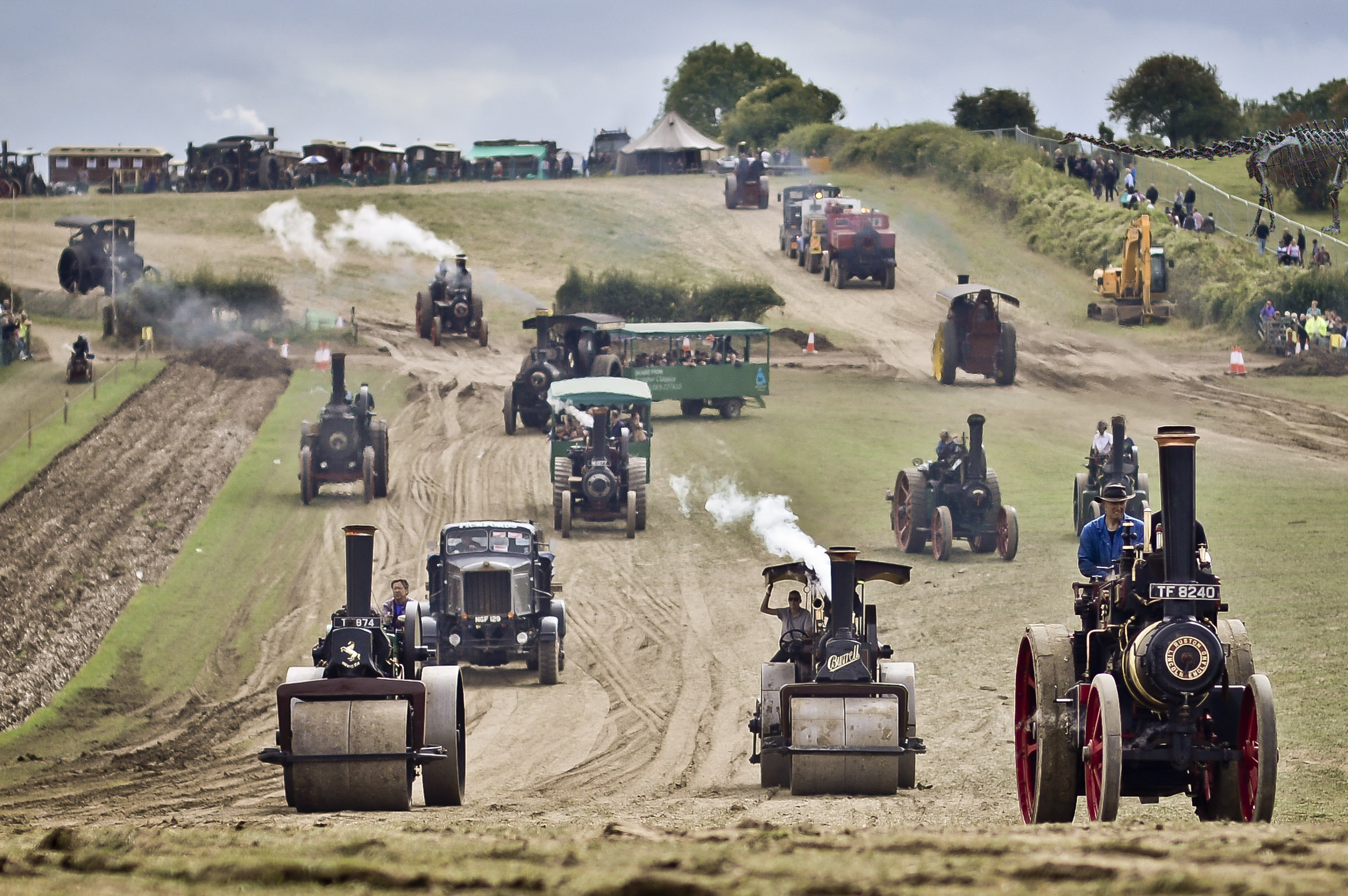 Traction engines, road rollers and other steam powered vehicles make their way around the main arena at the Great Dorset Steam Fair