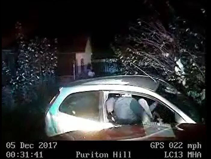 Callum Molloy exits his Ford Fiesta following a high-speed pursuit with police (Avon and Somerset Police/PA)