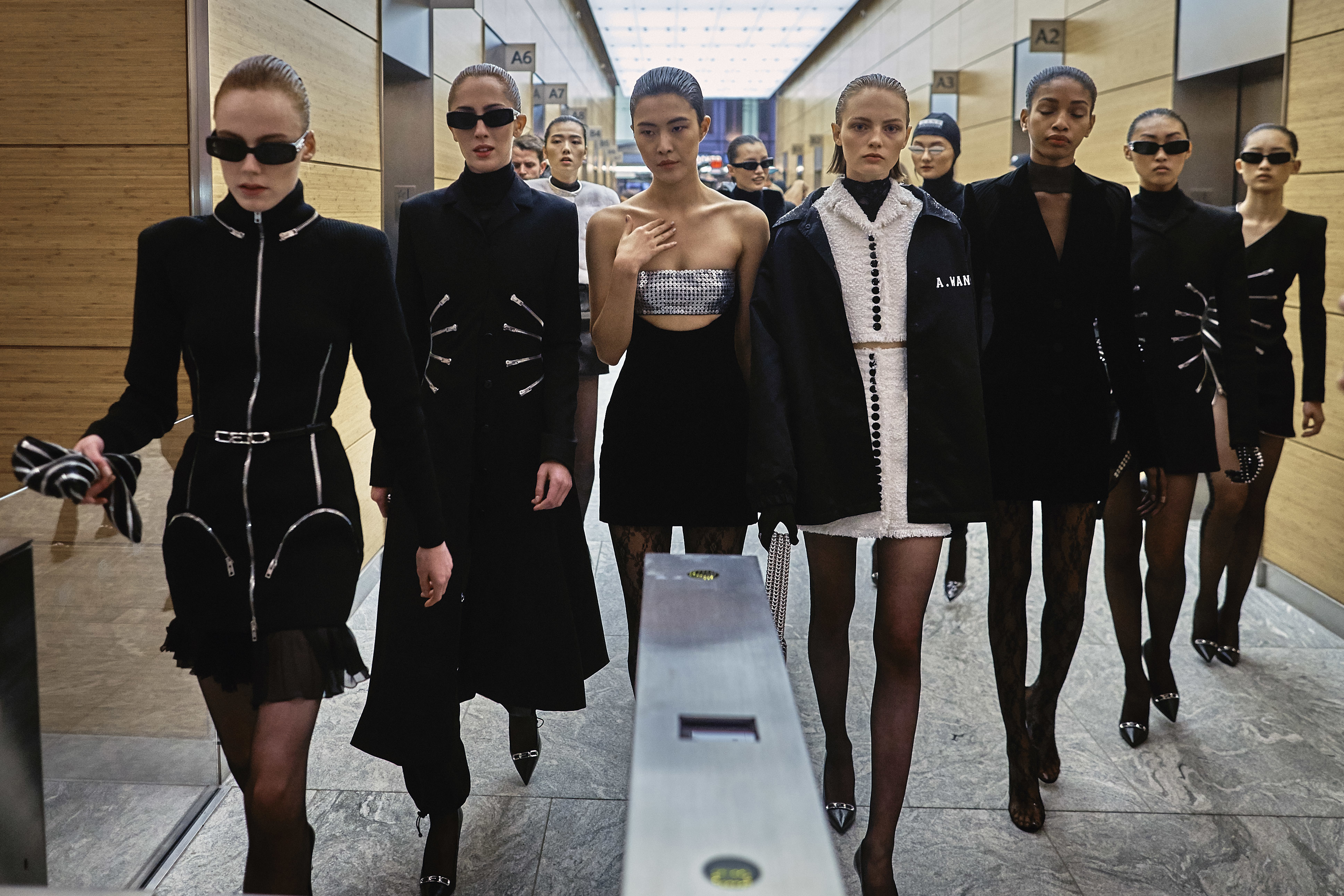 Models wearing the Alexander Wang collection walk to the street as part of the show during Fashion Week in New York (Andres Kudacki/AP)