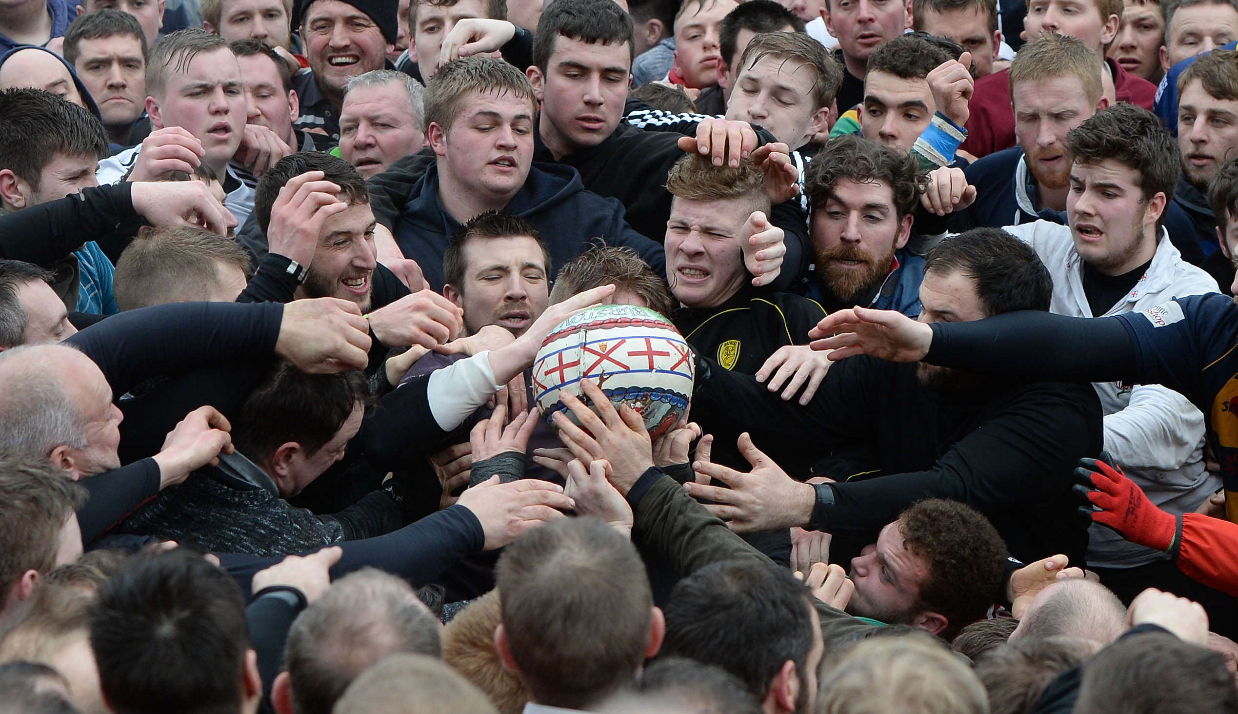 Players fight over the ball in Ashbourne (Joe Giddens/PA)