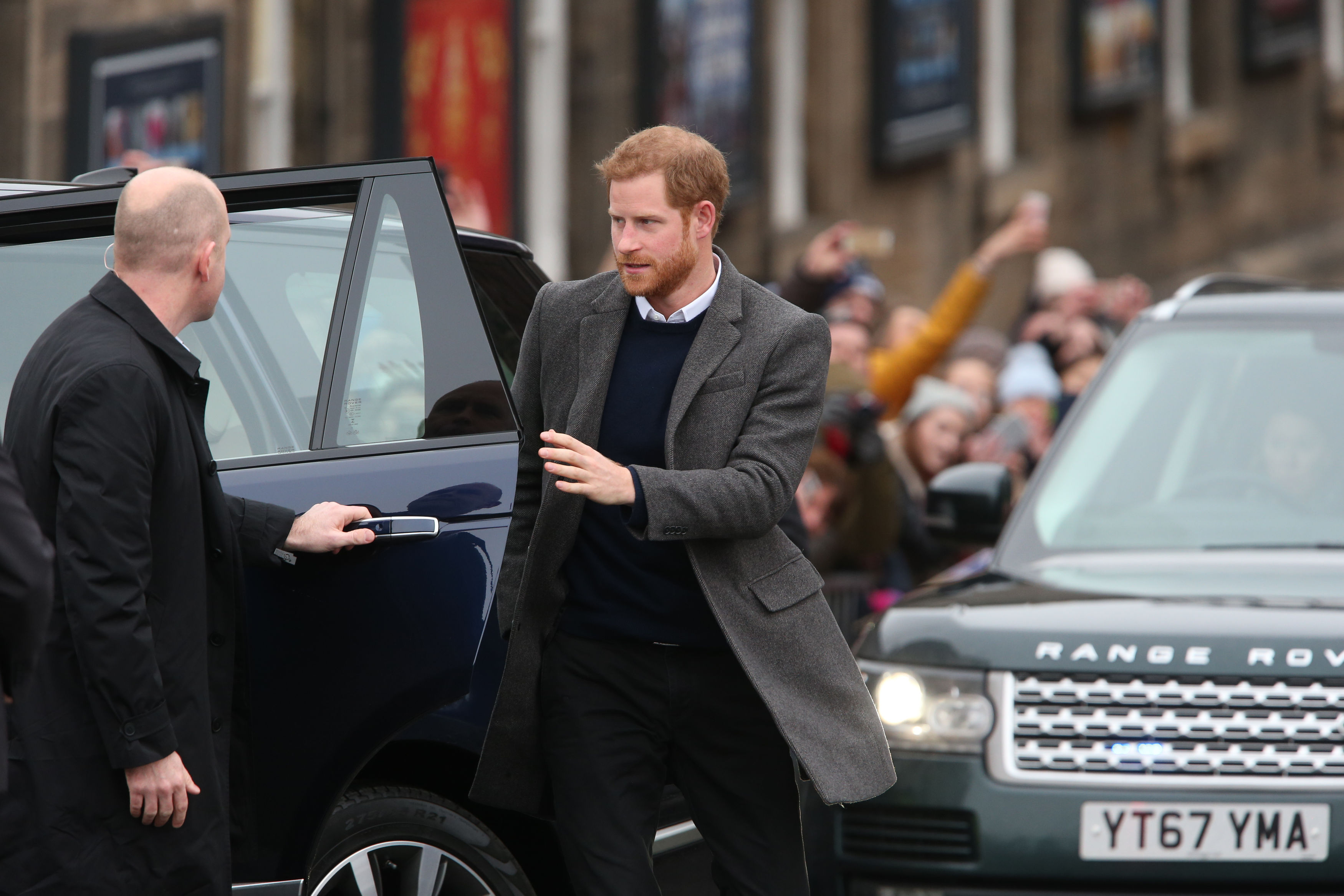 Prince Harry prepares to start his walkabout on the esplanade at Edinburgh Castle (Andrew Milligan/PA)