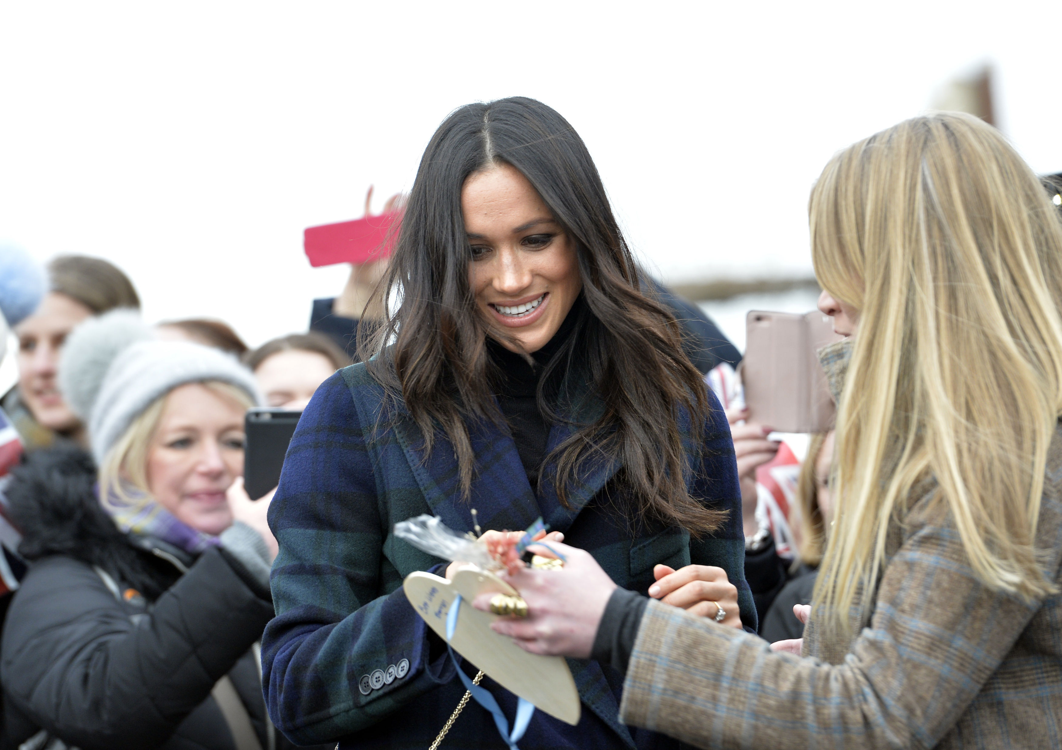 Onlookers presented gifts to Meghan Markle during her walkabout (John Linton/PA)