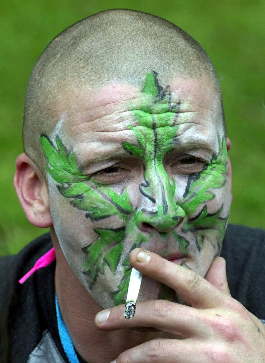 A man smokes a marijuana joint (Kirsty Wigglesworth/PA)