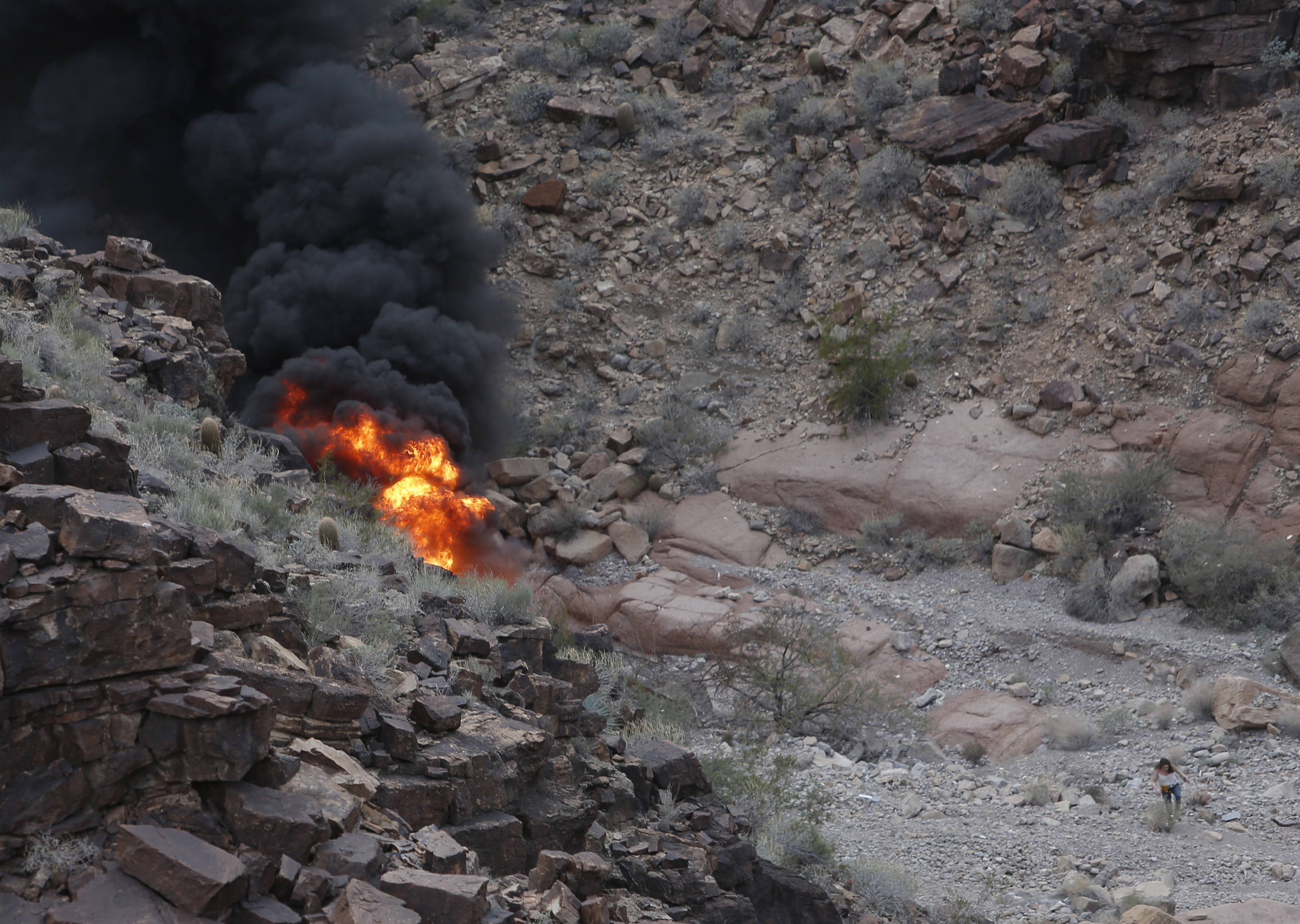 The wreckage of the crashed helicopter (Teddy Fujimoto/AP)