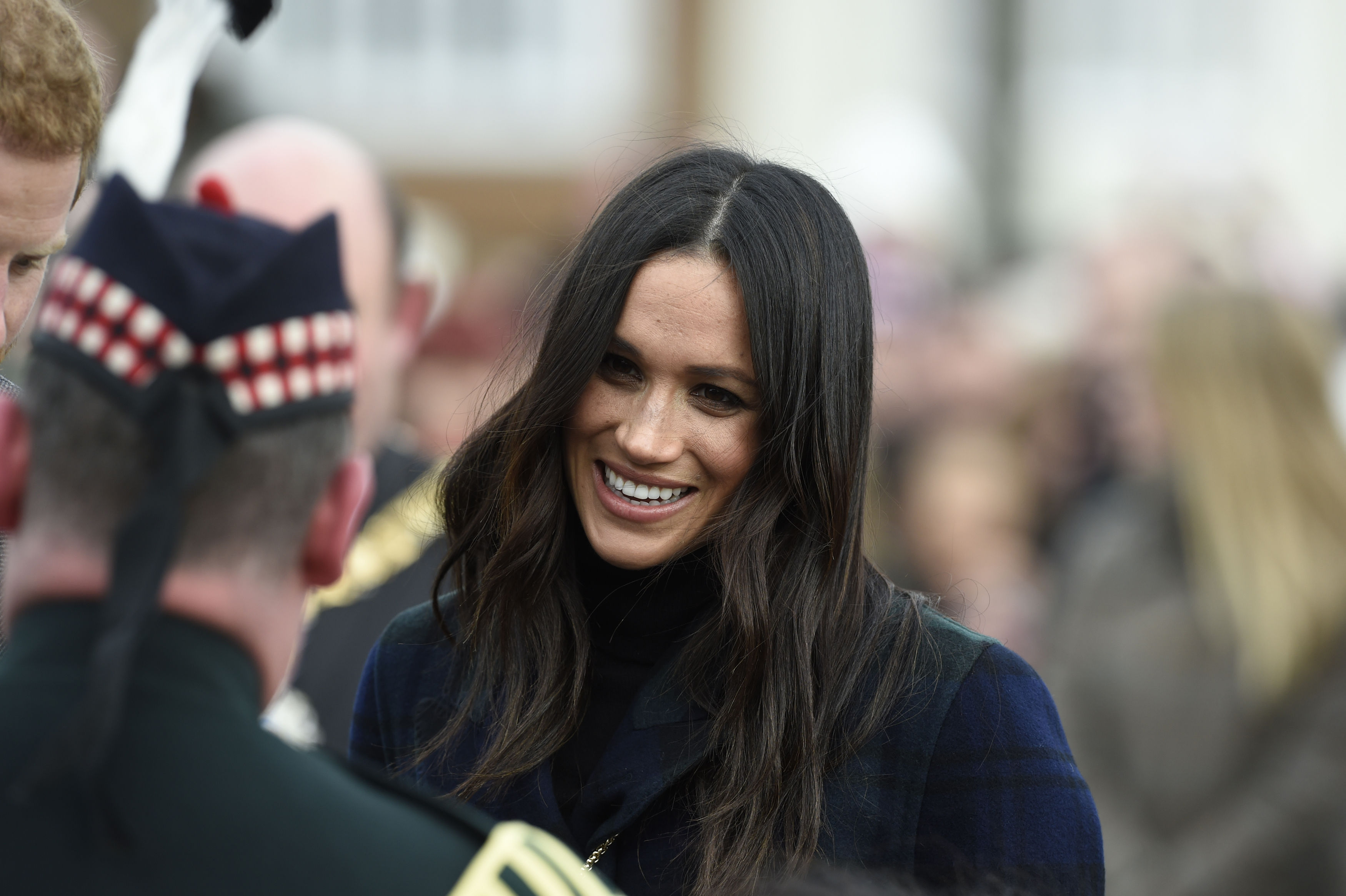 Ms Markle meets Pony Major Wilkinson during a walkabout (Ian Rutherford/PA)