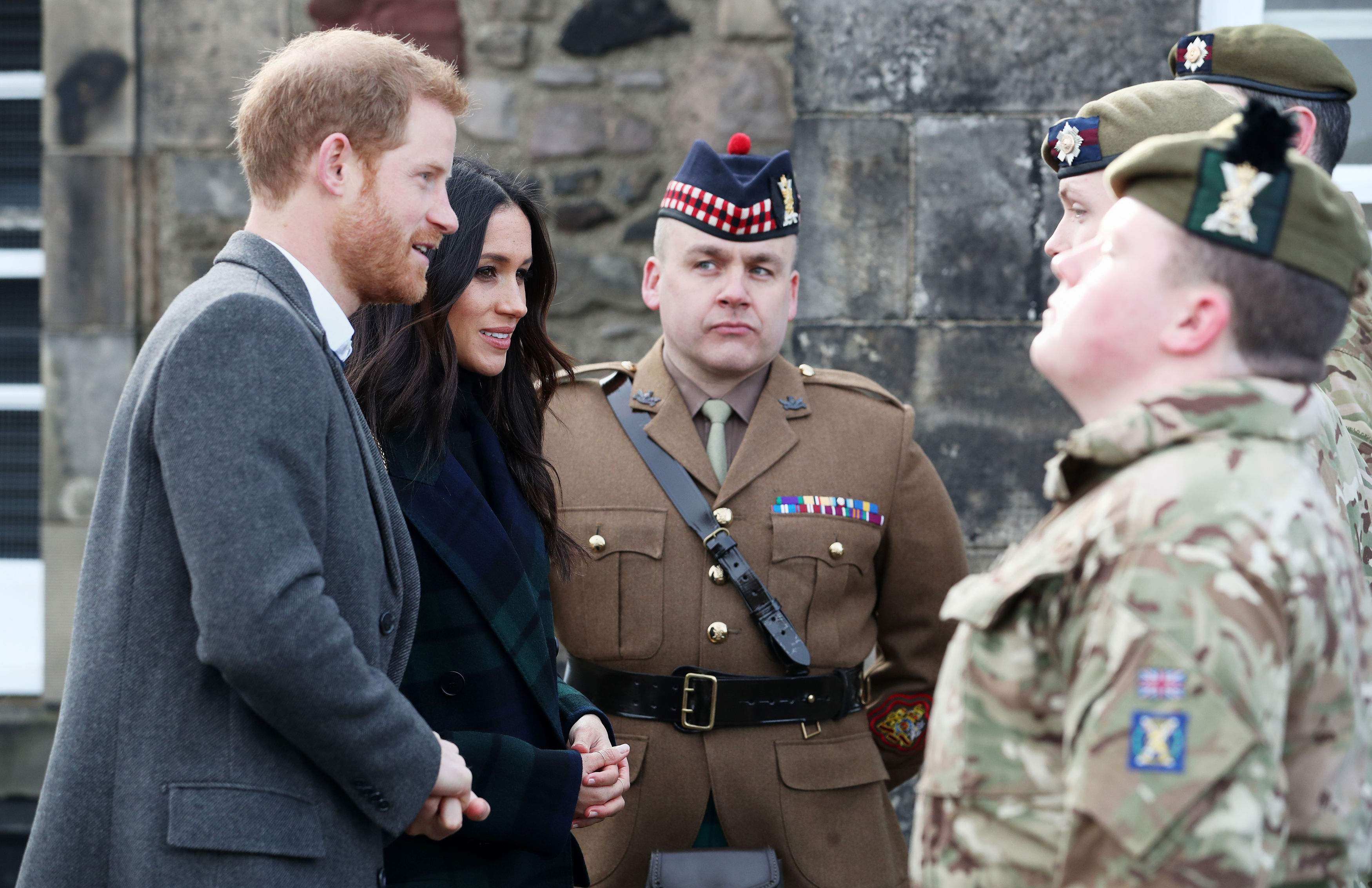 Harry and Ms Markle meet the gunners before the firing of the one o'clock gun (Jane Barlow/PA)