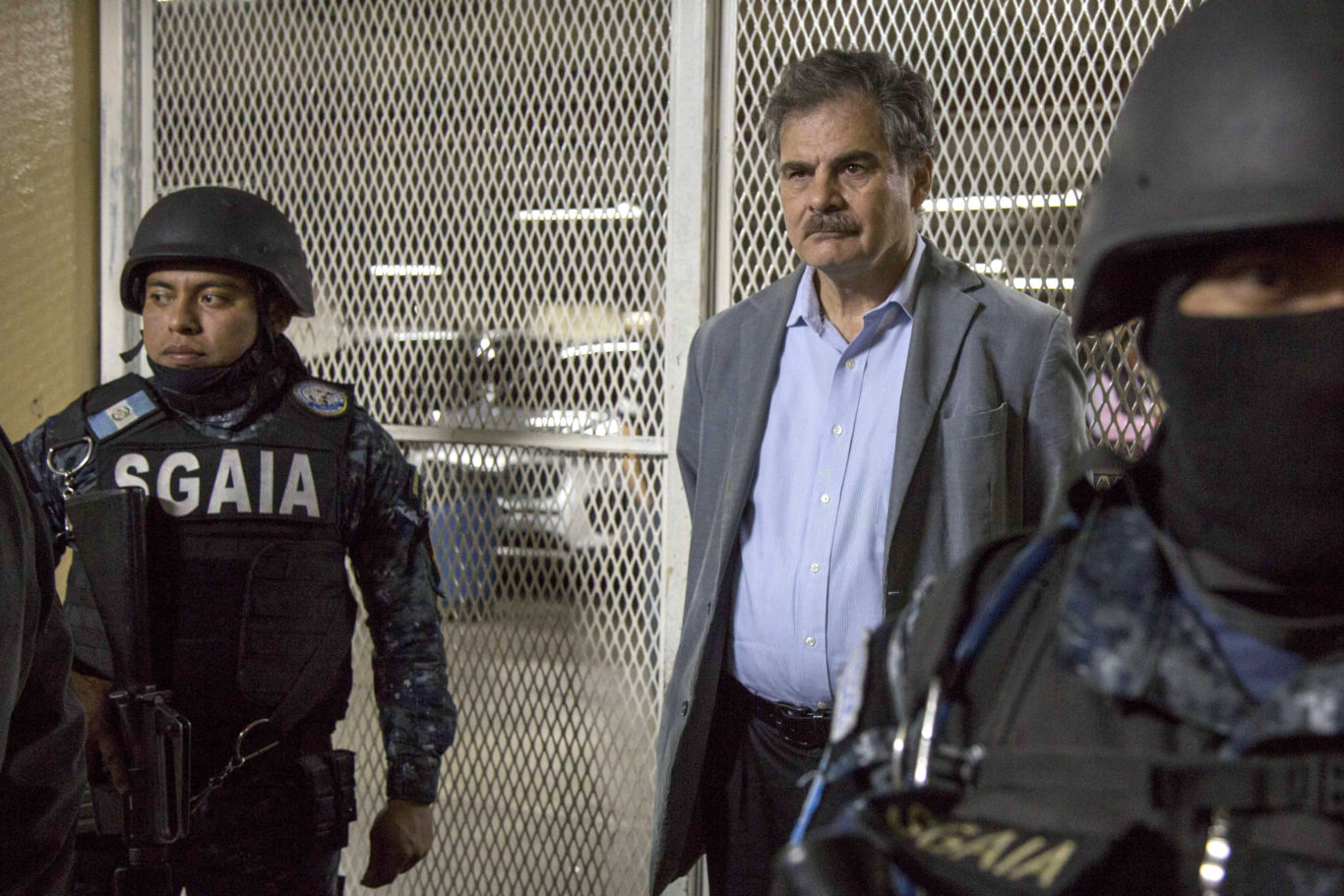 Former finance minister Juan Alberto Fuentes waits to enter a holding cell (AP/Luis Soto)